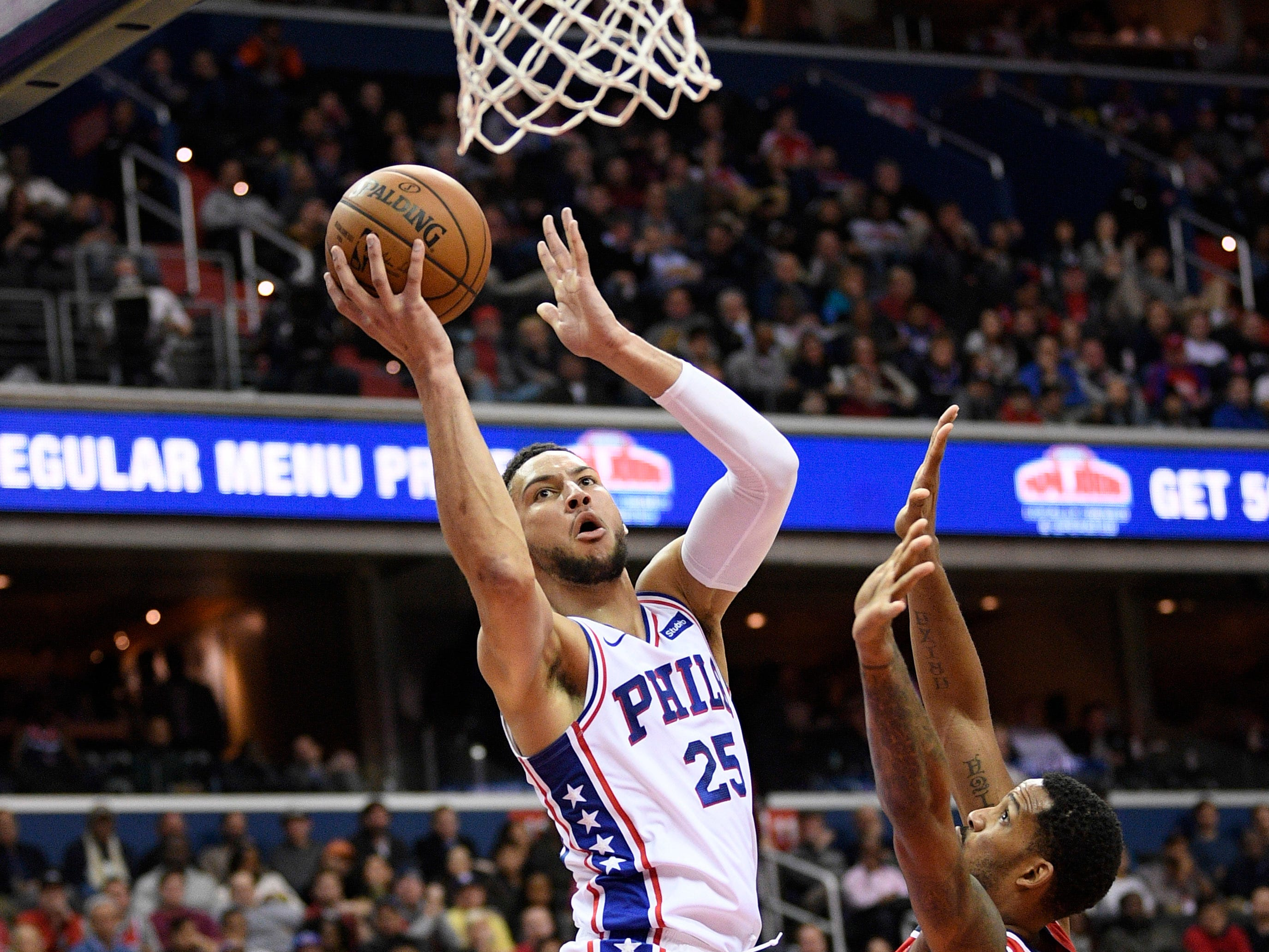 Philadelphia 76ers guard Ben Simmons (25) goes to the basket against Washington Wizards forward Trevor Ariza (1) during the first half of an NBA basketball game, Wednesday, Jan. 9, 2019, in Washington. (AP Photo/Nick Wass)