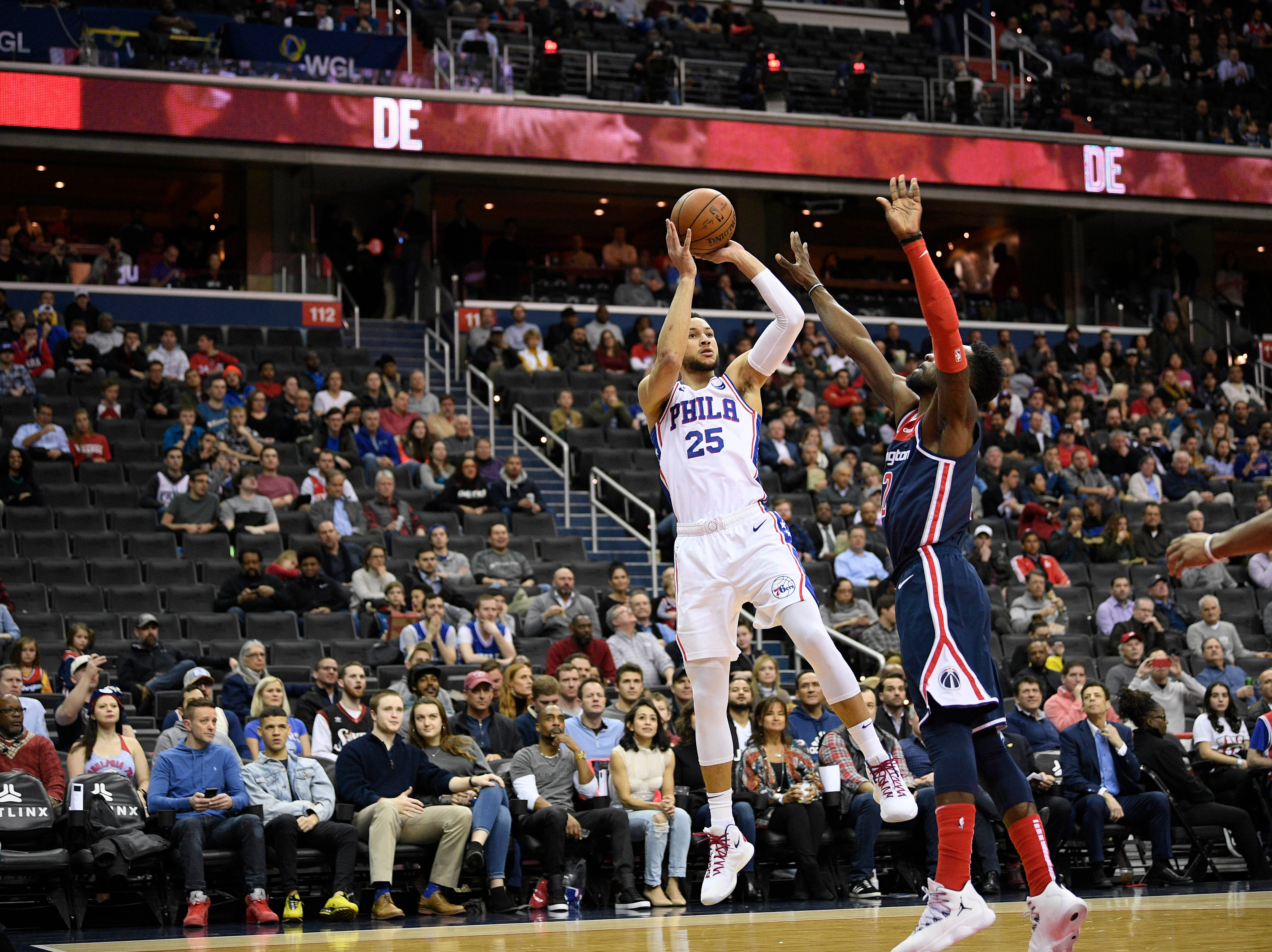 Philadelphia 76ers guard Ben Simmons (25) shoots against Washington Wizards forward Jeff Green, right, during the first half of an NBA basketball game, Wednesday, Jan. 9, 2019, in Washington. (AP Photo/Nick Wass)
