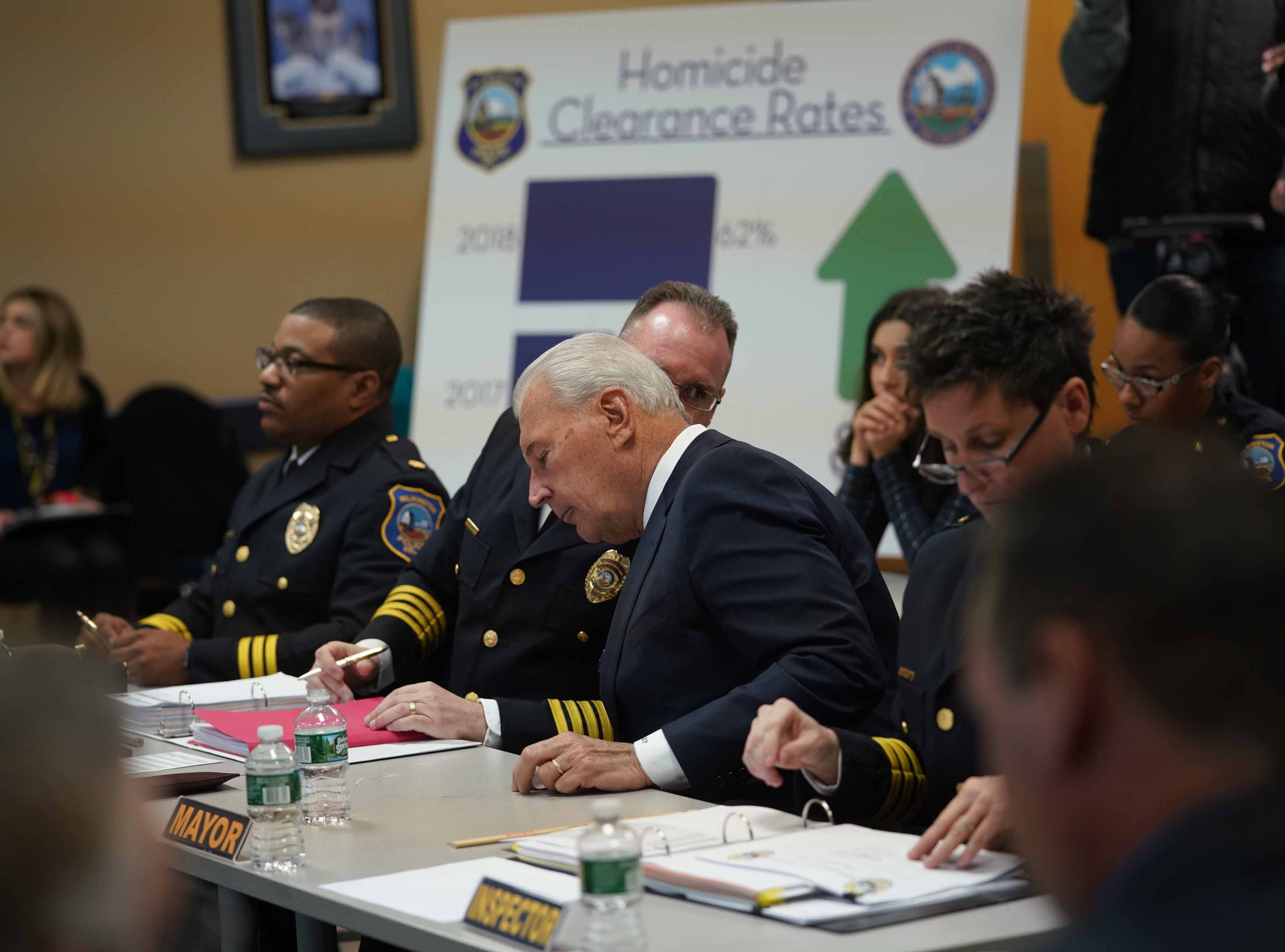 Wilmington Police Chief Robert Tracy and Wilmington Mayor Mike Purzycki converse during a meeting with staff from the police department that met to discuss the 2018 Comstat report that indicated a reduction in crime.