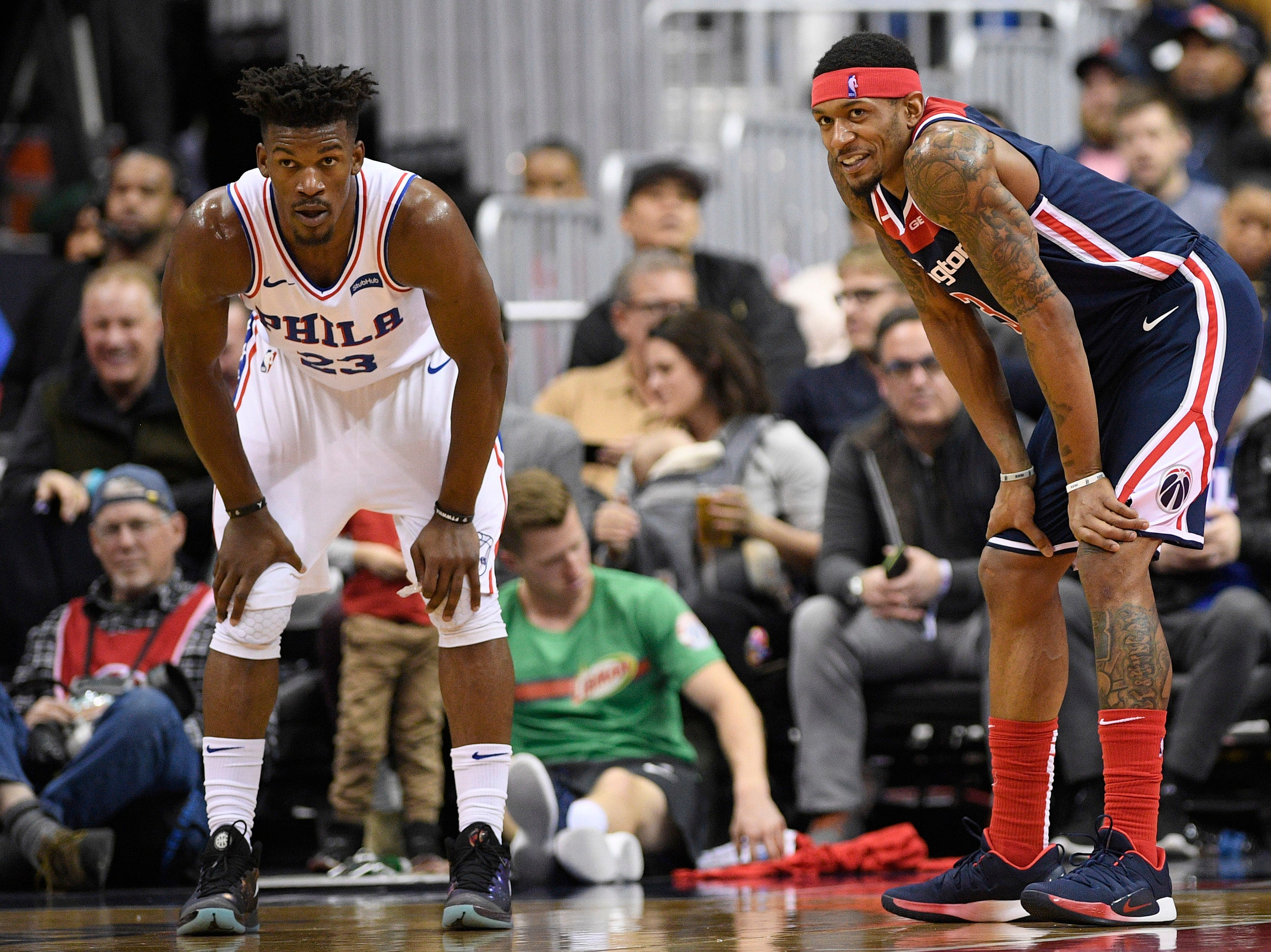 Washington Wizards guard Bradley Beal (3) reacts as he stands next to Philadelphia 76ers guard Jimmy Butler (23) during the second half of an NBA basketball game, Wednesday, Jan. 9, 2019, in Washington. The Wizards won 123-106. (AP Photo/Nick Wass)