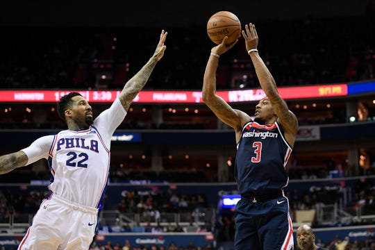 Washington Wizards guard Bradley Beal (3) shoots against Philadelphia 76ers forward Wilson Chandler (22) during the second half of an NBA basketball game, Wednesday, Jan. 9, 2019, in Washington. The Wizards won 123-106. (AP Photo/Nick Wass)