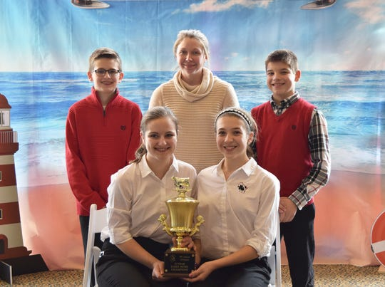 Winning first place in the junior division of the Dairy Bowl competition for the second year in a row was the Manitowoc/Calumet County team, front row (from left) Clarissa Ulness and Brianna Meyer. Back row (from left) Garett Ulness, coach Amanda Smith, and Austin Meyer.