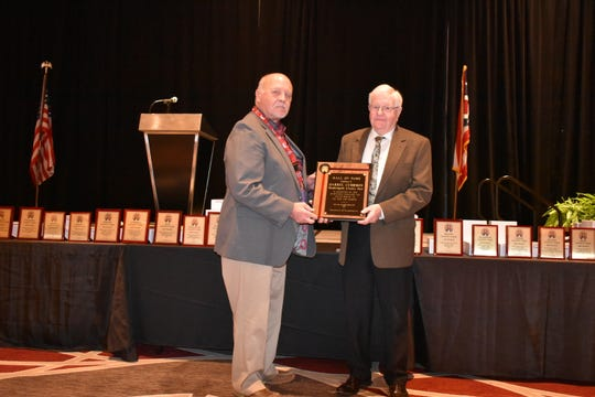 Darrel Cubbison accepts a plaque as he is inducted into the Ohio Fairs Hall of Fame on Sunday, Jan. 6, 2018.