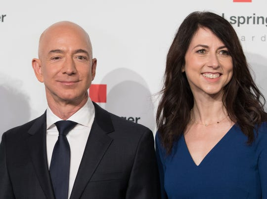 Amazon CEO Jeff Bezos and then-wife MacKenzie Bezos pose as they arrive at the headquarters of publisher Axel-Springer on April 24, 2018, where he will receive the Axel Springer Award 2018 in Berlin.