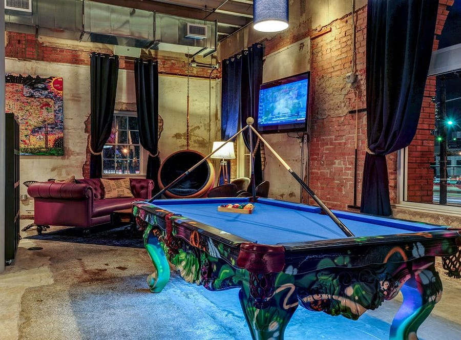 The CANVAS Hotel Dallas has a lounge with a pool table.