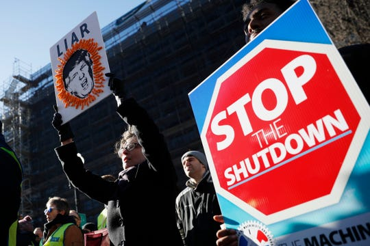 Union members and other federal employees rally to call for an end to the partial government shutdown, Jan. 10, 2019 at AFL-CIO Headquarters in Washington.