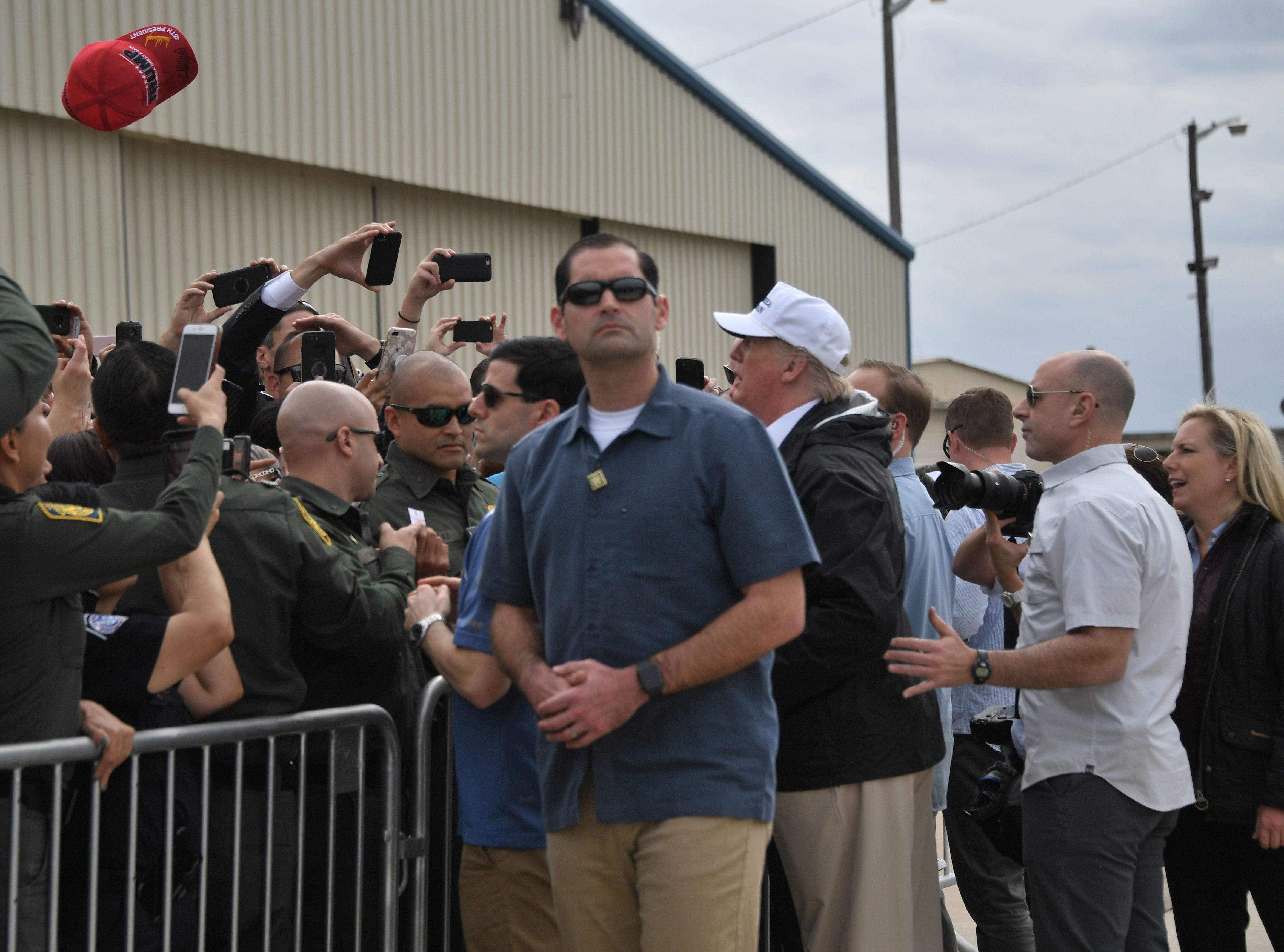 President Donald Trump visits US Border Patrol McAllen Station in McAllen, Texas, on Jan. 10, 2019, with Homeland Security Secretary Kirstjen Nielsen, right. Trump travels to the US-Mexico border as part of his all-out offensive to build a wall, a day after he stormed out of negotiations when Democratic opponents refused to agree to fund the project in exchange for an end to a painful government shutdown.