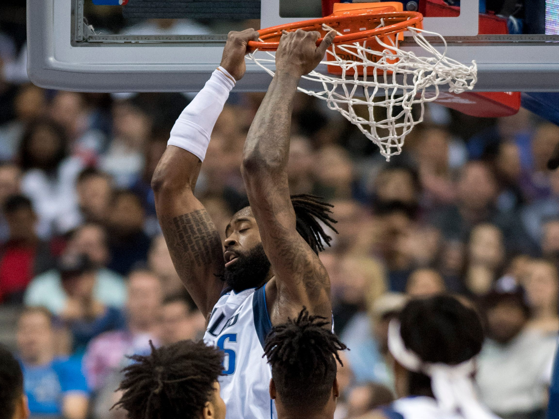 Jan. 9: Mavericks center DeAndre Jordan throws down a reverse two-handed slam during the second half against the Suns in Dallas.