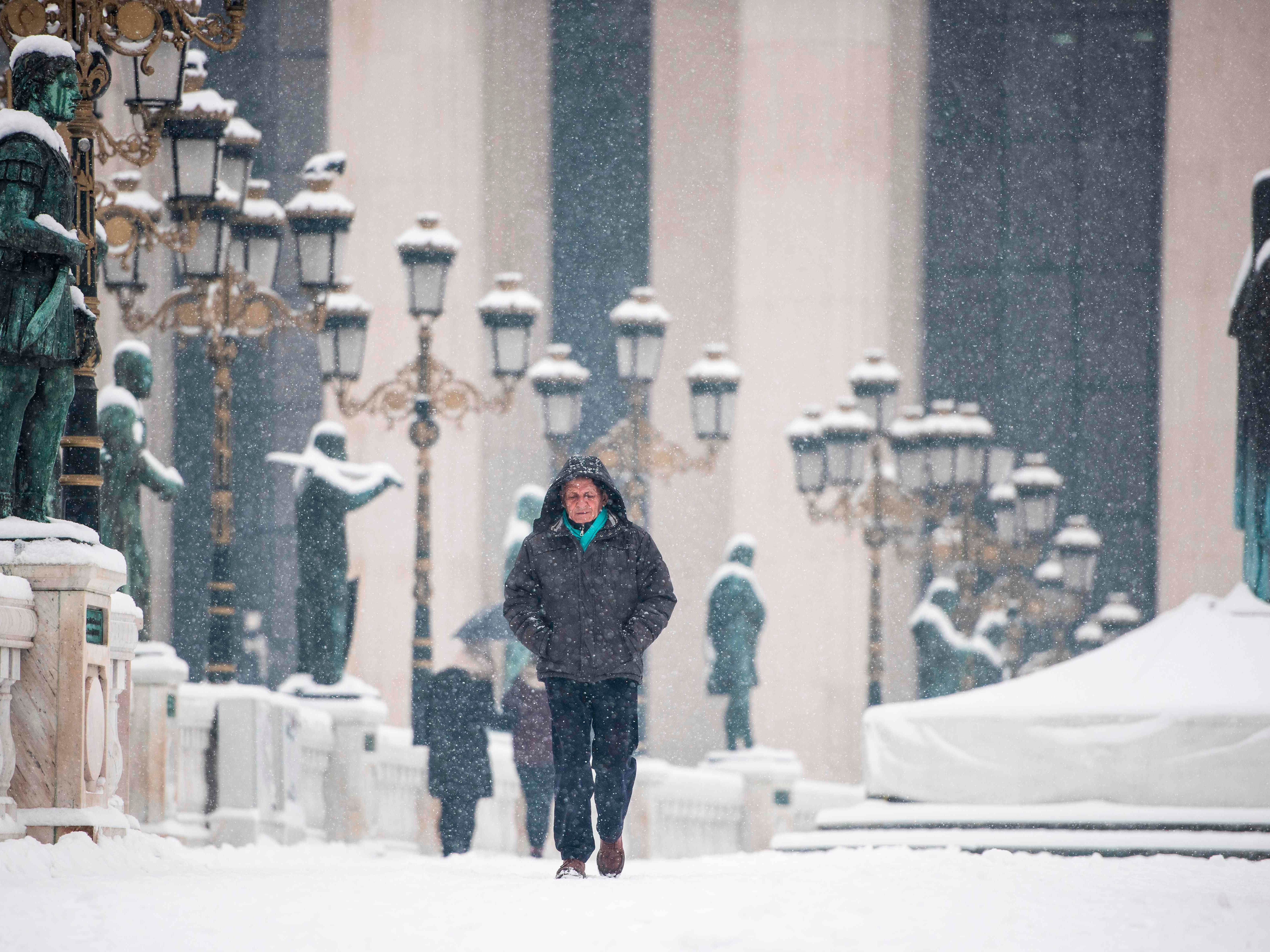A woman walks on a snow-covered bridge during a heavy snowfall in Skopje, an. 10, 2019 as Macedonia was affected by heavy snow storms in the last two days.