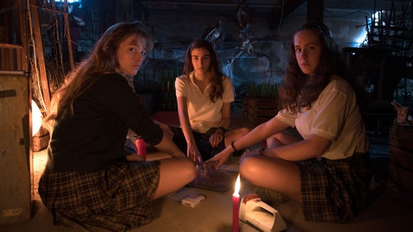 """Three teens (from left, Carla Campra, Sandra Escacena and Angela Fabian) make the mistake of messing with a Ouija board in """"Veronica."""""""