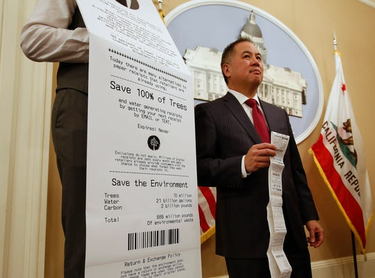 Assemblyman Phil Ting, D-San Francisco, displays a long paper receipt as he discusses his bill to require businesses to offer electronic receipts on Jan. 8 in Sacramento. Under the legislation, customers could receive a paper receipt on request.