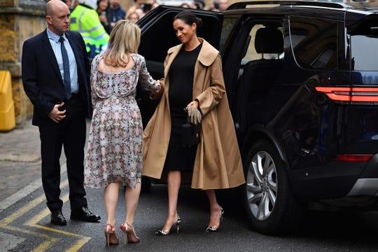 Meghan wore an Oscar de la Renta coat for her visit.