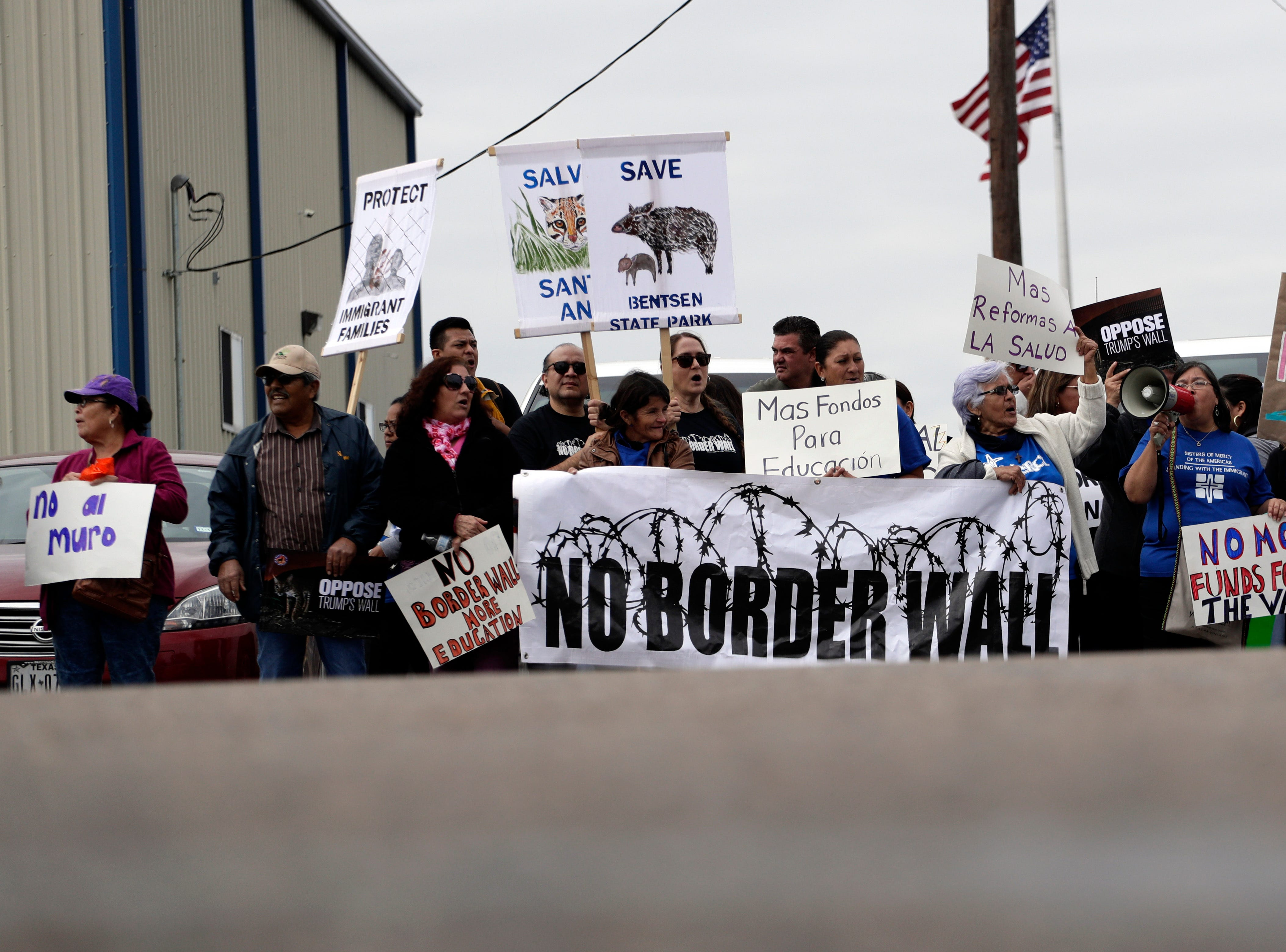 Groups opposed to border walls being built along the Texas-Mexico border gather outside the McAllen International Airport as they wait for the arrival of President Donald Trump who is making a visit to the southern border, Thursday, Jan. 10, 2019, in McAllen, Texas.