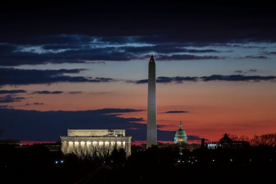 The Washington skyline is seen on day 19 of a partial government shutdown on the morning after President Donald Trump used a prime-time TV address from the Oval Office to urge congressional Democrats to relent on their opposition to his proposed U.S.-Mexico border wall, Wednesday, Jan. 9, 2019. From left are the Lincoln Memorial, the Washington Monument, and the U.S. Capitol.