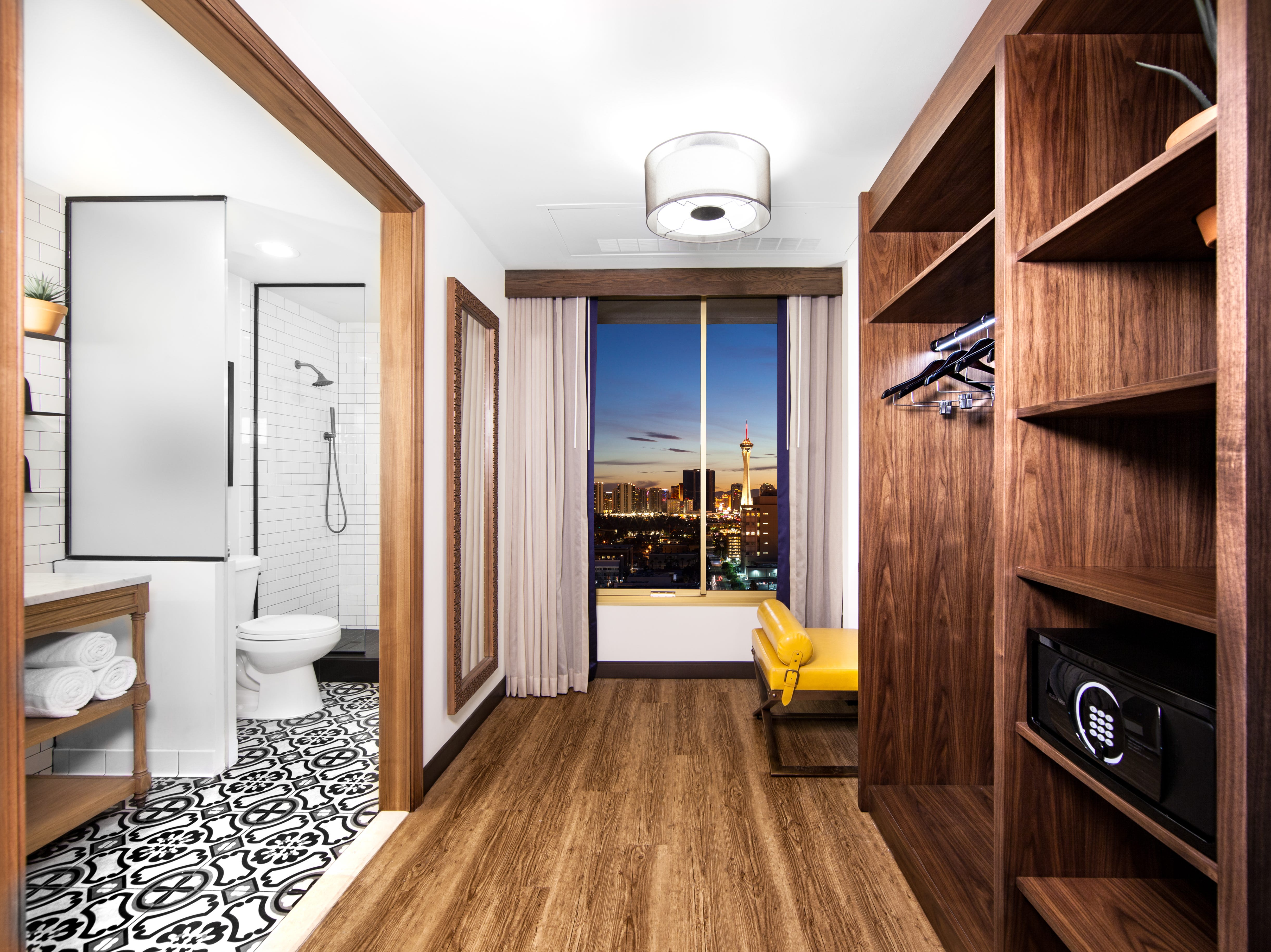 The redesigned rooms now have black and white floor tiles, traditional-style rugs, carved wood details and modern accent furniture.