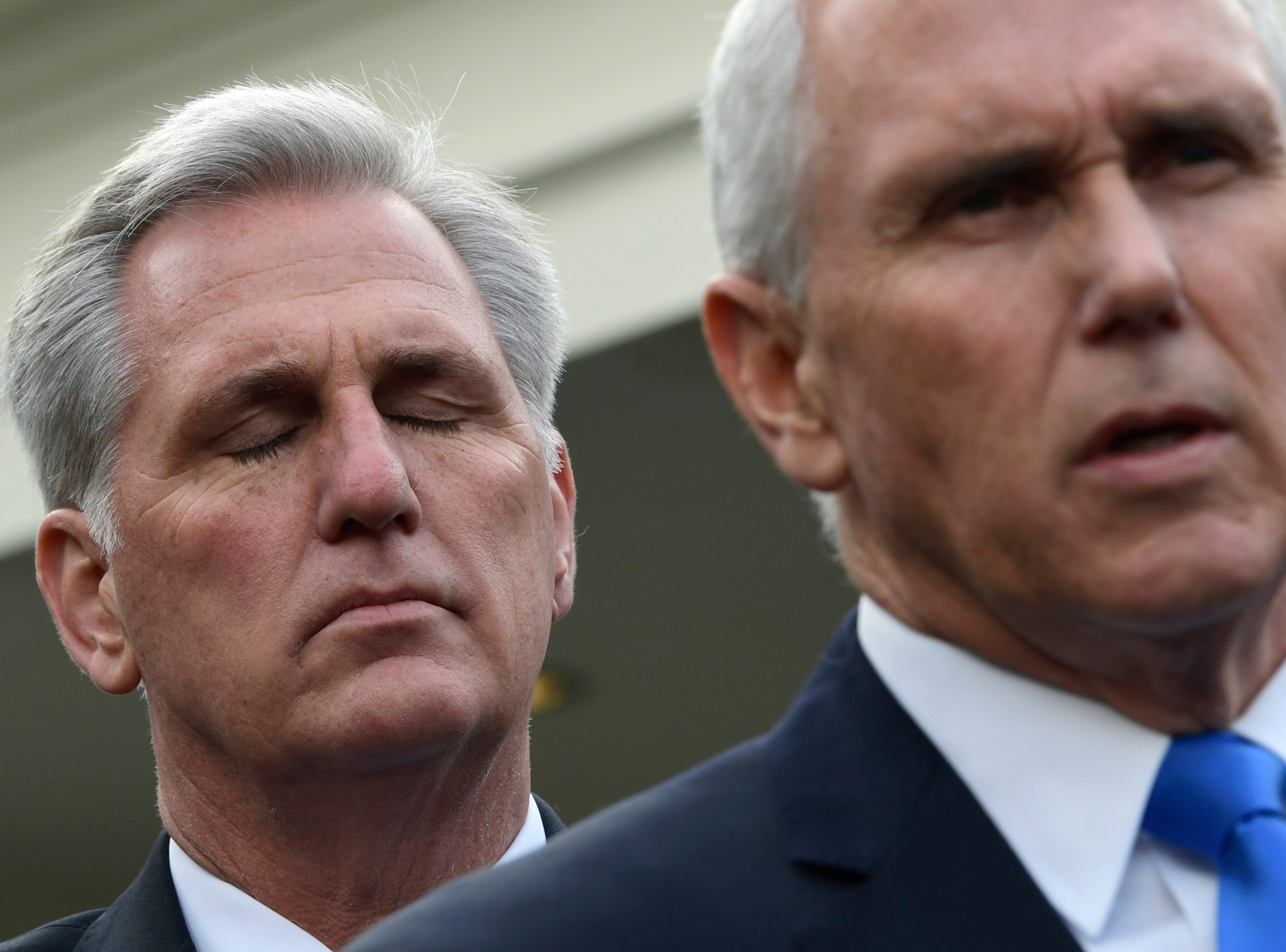 House Minority Leader Kevin McCarthy of Calif., left, listens as Vice President Mike Pence, right, speaks to reporters following a meeting with President Donald Trump and Democratic congressional leaders at the White House in Washington, Wednesday, Jan. 9, 2019.