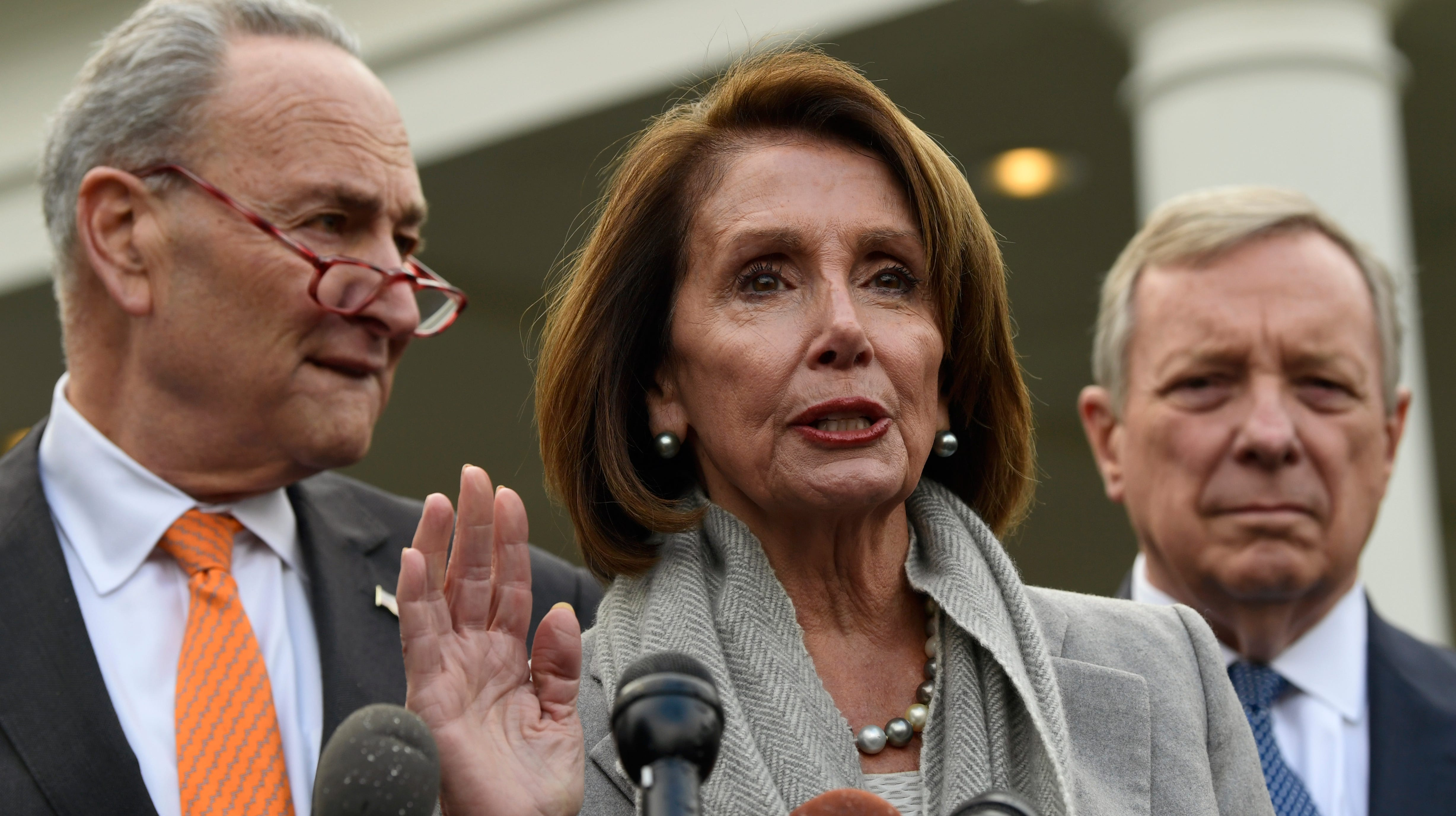 House Speaker Nancy Pelosi of Calif., center, speaks about her oath of office as she stands next to Senate Minority Leader Sen. Chuck Schumer of N.Y., left, and Sen. Dick Durbin, D-Ill., right, following their meeting with President Donald Trump at the White House in Washington, Wednesday, Jan. 9, 2019.