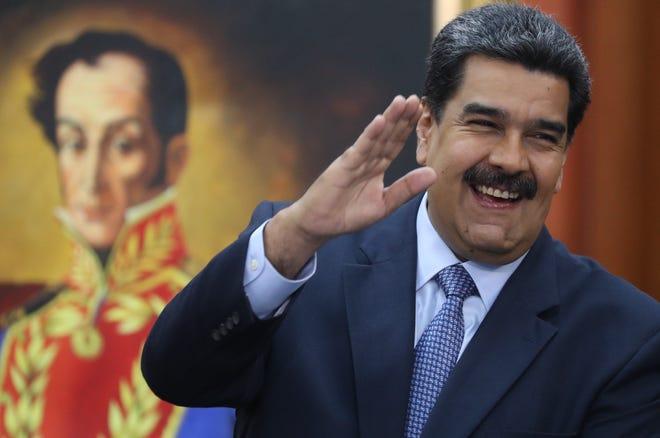 Venezuelan President Nicolas Maduro gestures during a press conference in Caracas, Venezuela.