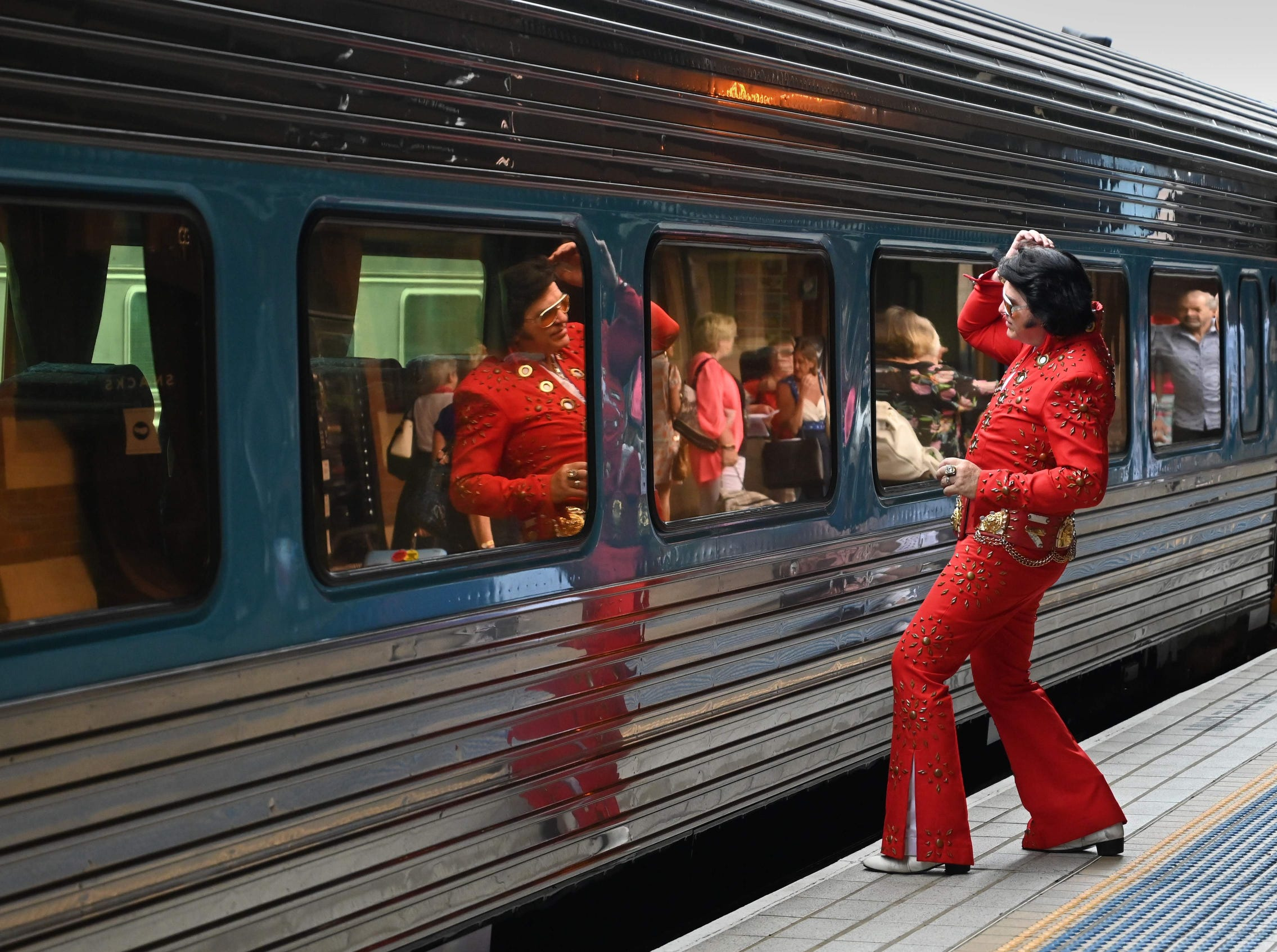 An Elvis fan checks his reflection at Central station before boarding a train to The Parkes Elvis Festival.