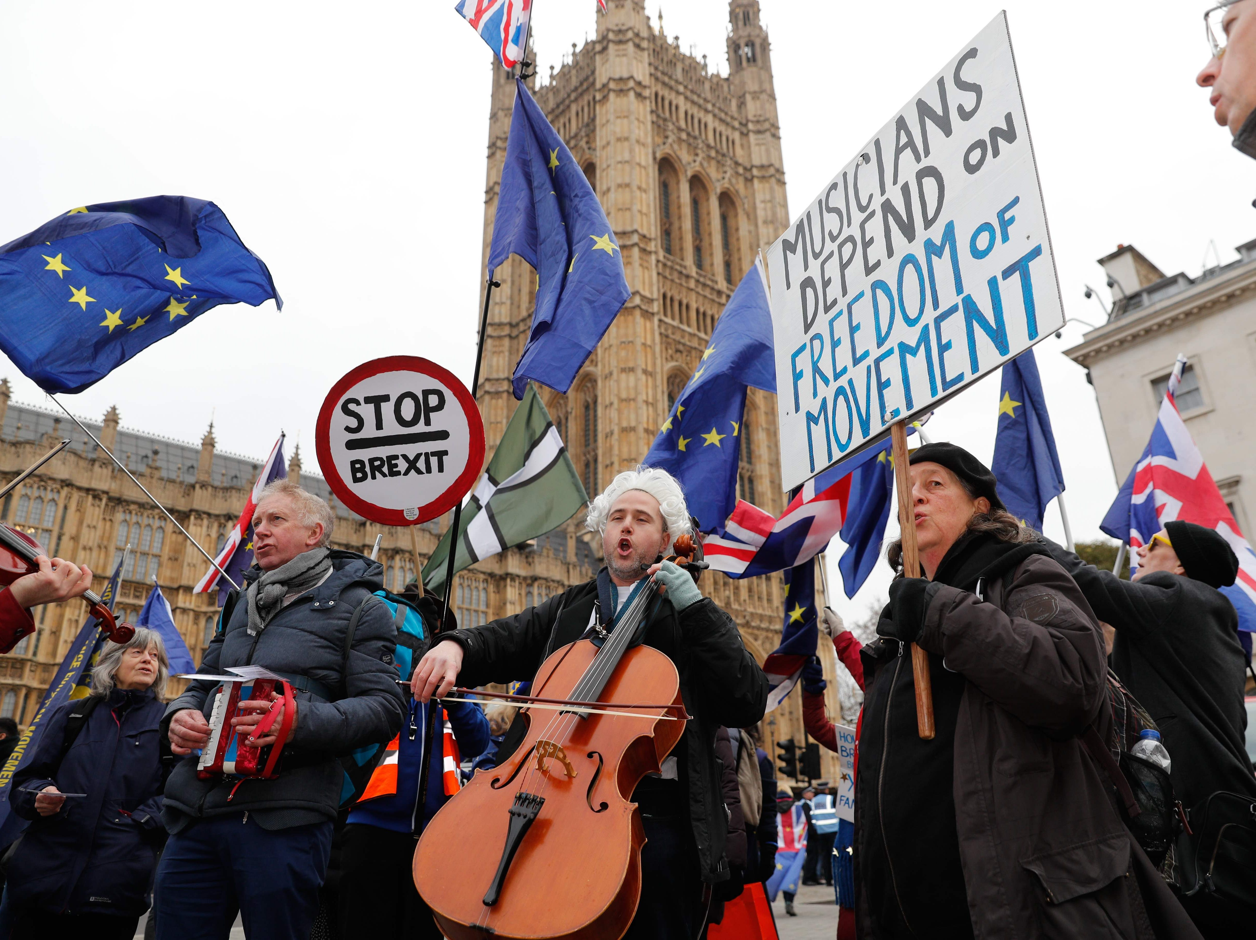 British-German musician Simon Wallfisch, center, plays the cello and sings with supporters and fellow musicians outside the Houses of Parliament in London on Jan. 10, 2019 during a performance to protest Britain's exit from the European Union (Brexit).  Classical singer and cellist Simon Wallfisch, whose family were persecuted by the Nazis, recently applied for and received German citizenship because of Brexit. Since the UK invoked Article 50 starting the countdown to Britain's exit from the European Union Simon and a group of supporters have once a month marched past the Houses of Parliament performing Beethoven's Ode to Joy as a musical protest against Brexit.
