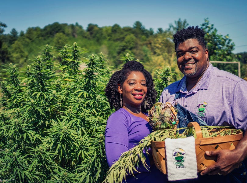 """In this September 2018 Clarenda """"Cee"""" Stanley-Anderson and her husband, Malcolm Anderson Sr., promote their hemp-farming business, Green Heffa Farms, Inc., in Liberty, N.C.  Hemp is about to get the federal legalization that marijuana, its cannabis cousin, craves. That unshackling at the national level sets the stage for greater expansion in an industry seeing explosive growth through demand for CBDs, the non-psychoactive compound in hemp that many see as a way to better health."""