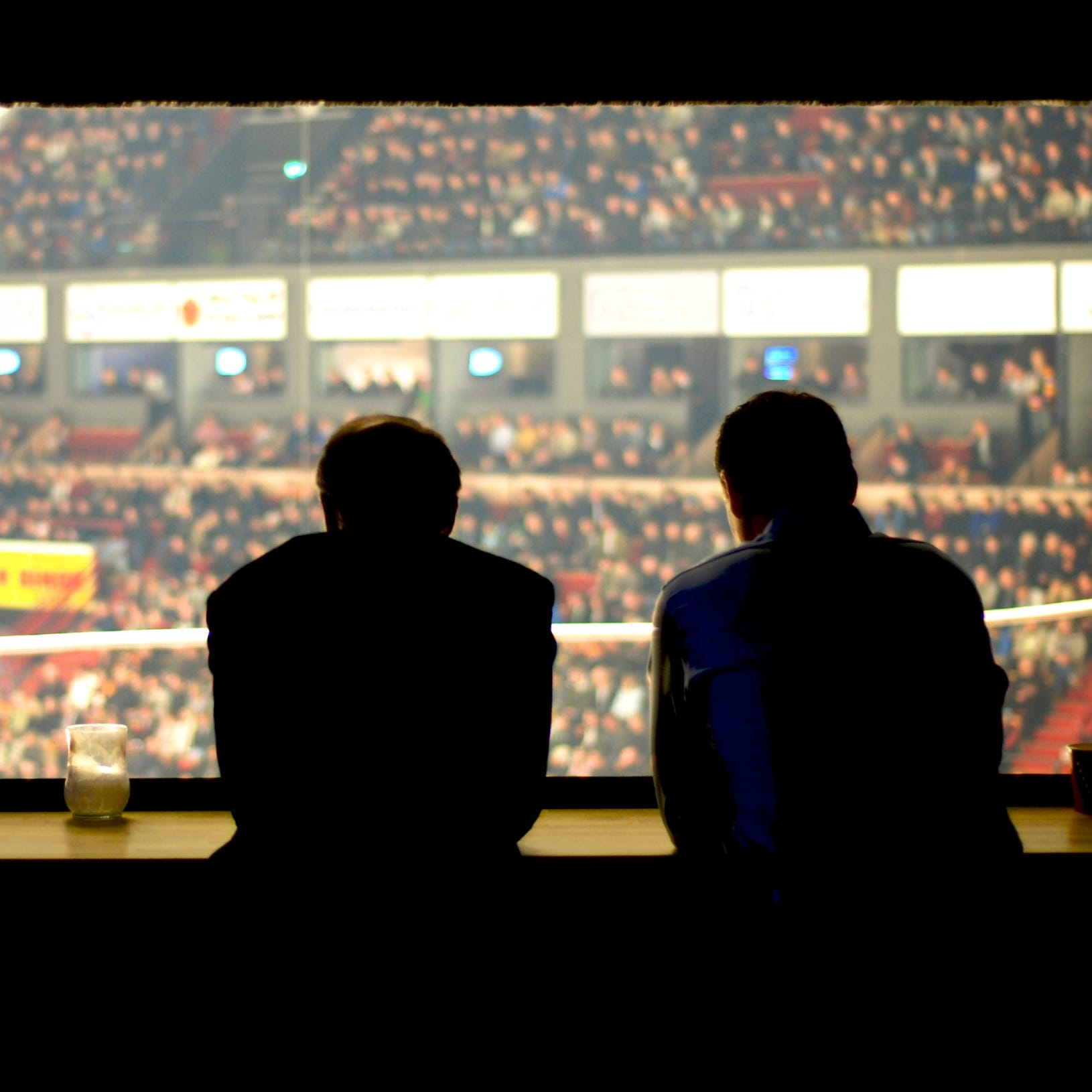Sports casters in press room commenting on the game.