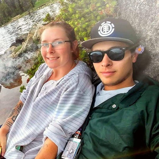 Tailor Gutierrez (left) poses next to Mirror Lake, Utah, with her boyfriend, Cody Lyon.