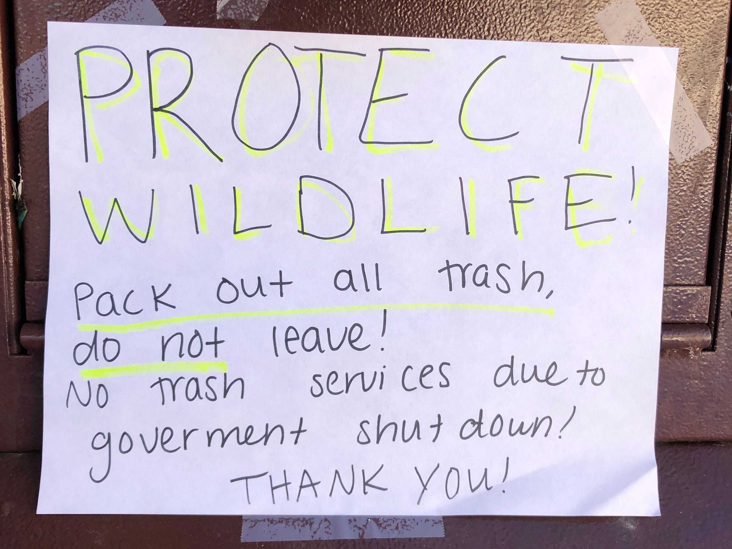 A sign on a garbage can at Rocky Mountain National Park in Colorado tells visitors to take their trash with them during the partial government shutdown on Jan. 4, 2019.