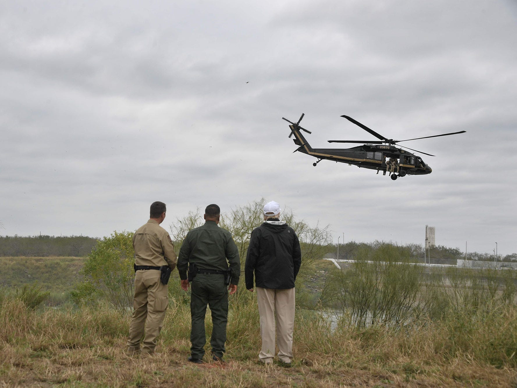 President Donald Trump stands with Border Patrol agents at the Rio Grande after his visit to US Border Patrol McAllen Station in McAllen, Texas, on Jan. 10, 2019. Trump traveled to the US-Mexico border as part of his all-out offensive to build a wall, a day after he stormed out of negotiations when Democratic opponents refused to agree to fund the project in exchange for an end to a painful government shutdown.