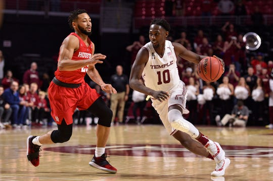 Temple guard Shizz Alston Jr., dribbling past Houston guard Galen Robinson Jr., had 12 points, six rebounds and six assists in the 73-69 win.