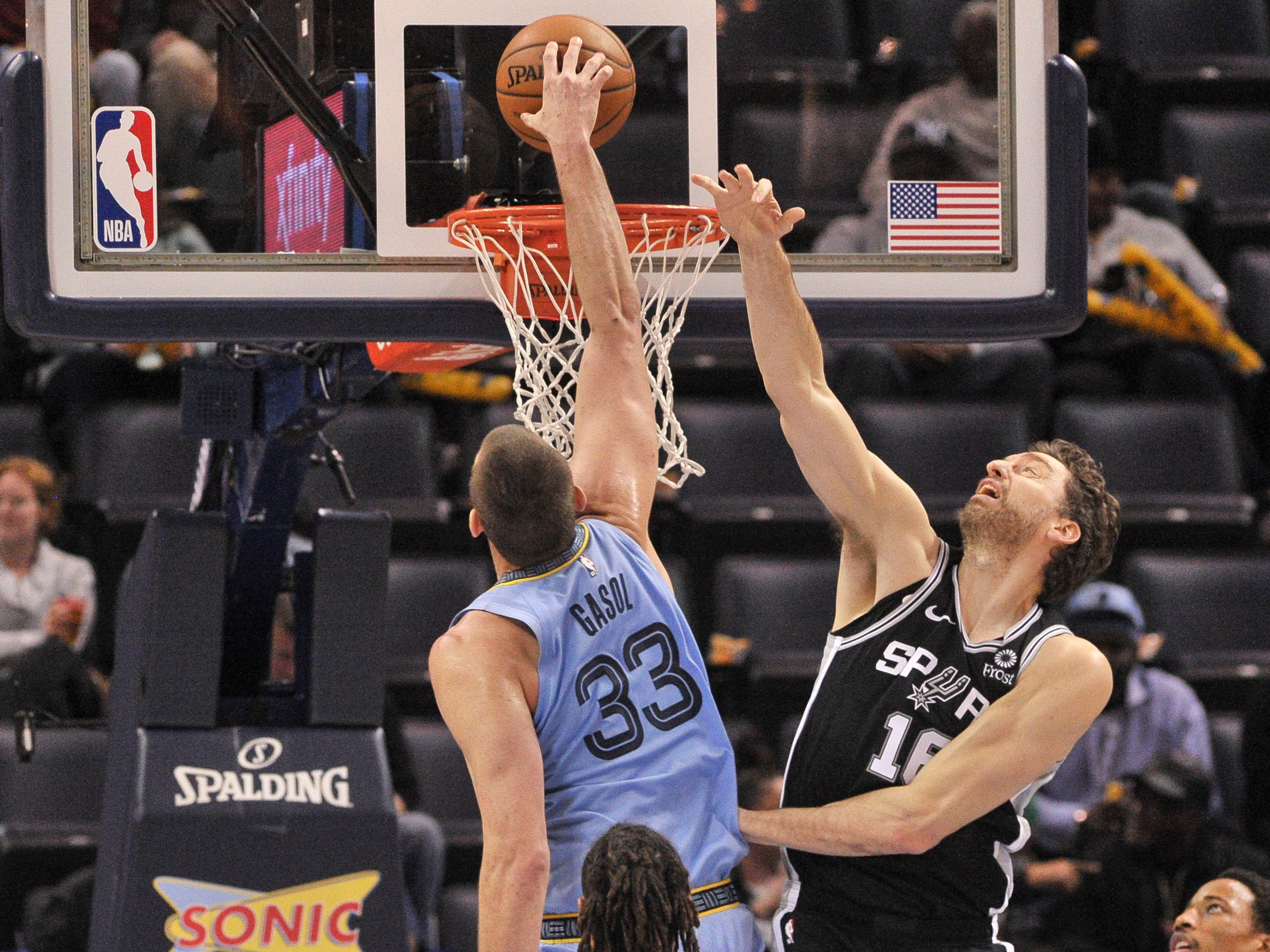 Jan. 9: Oh, brother. Grizzlies center Marc Gasol (33) throws down a one-handed slam over Spurs defender Pau Gasol (16) during the second half in Memphis.