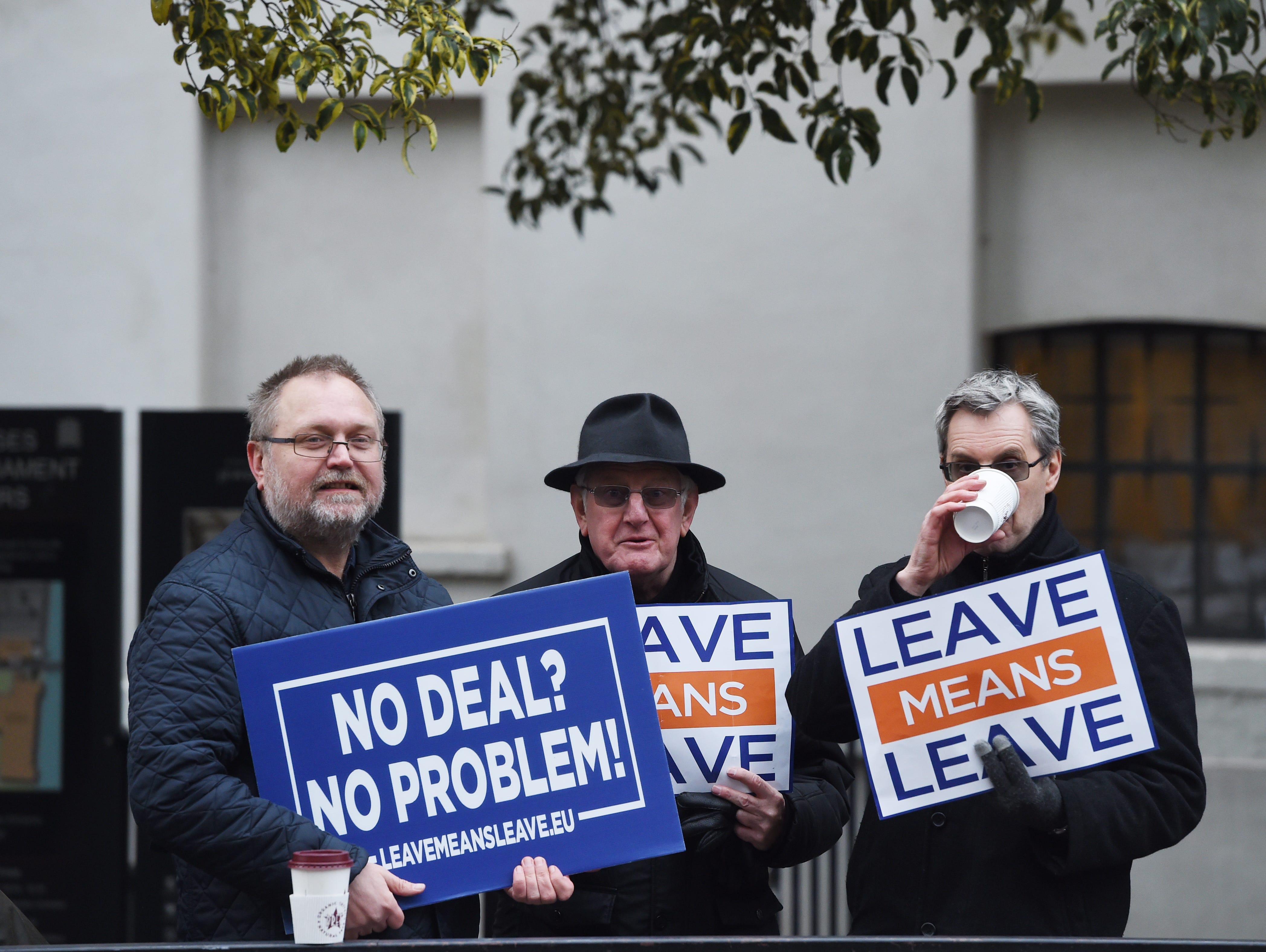 Pro Brexit supporters display signs outside the Houses of Parliament in Westminster in London, Britain on Jan. 10, 2019.