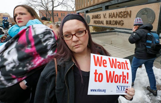 Internal Revenue Service worker Christine Helquist looks on during a federal workers protest rally at the Federal Building in Ogden, Utah, JAn. 10, 2019.