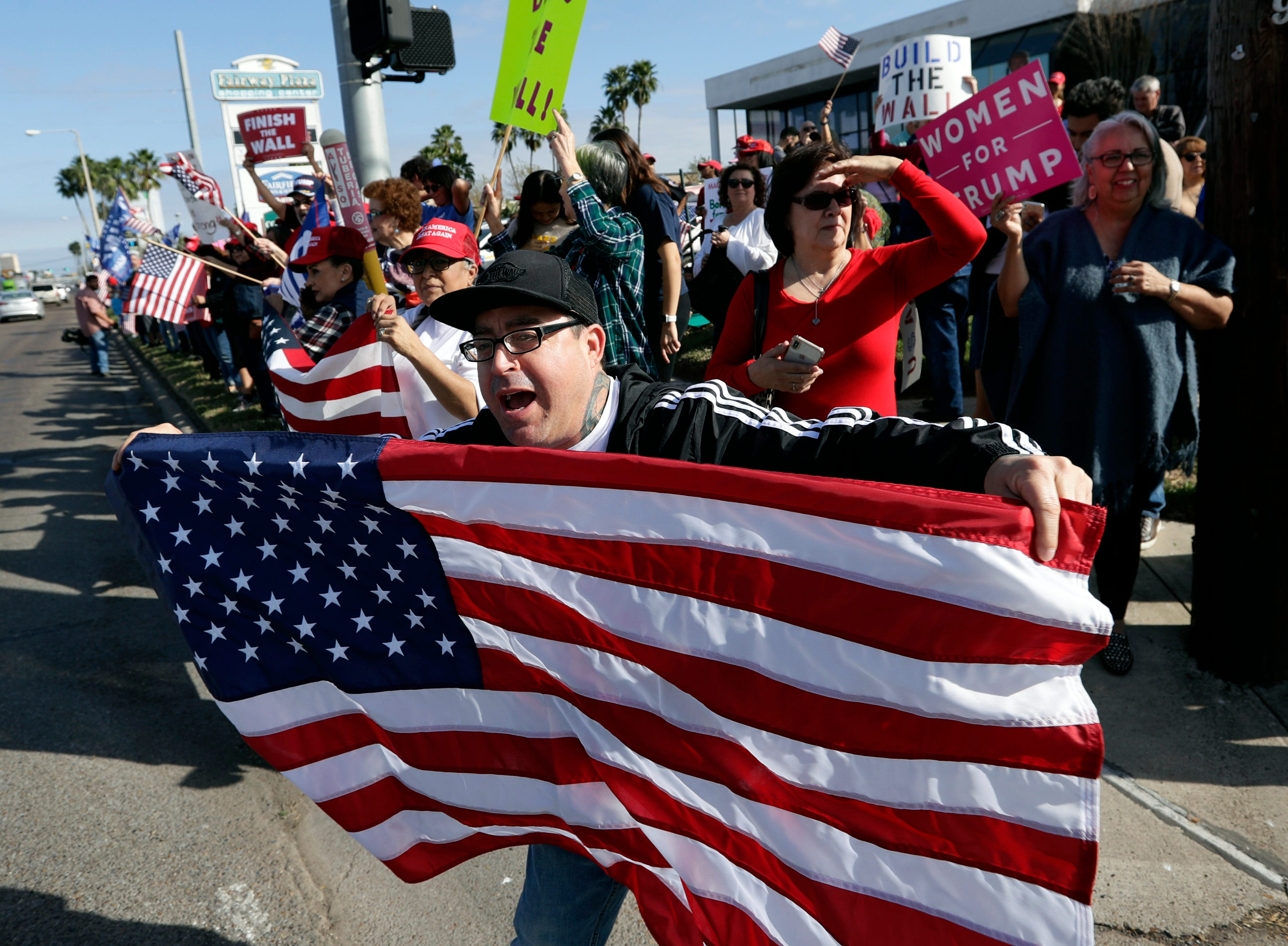 Supporters of President Donald Trump gather outside the McAllen International Airport for Trump's Jan. 10 visit to the southern border in McAllen, Texas.