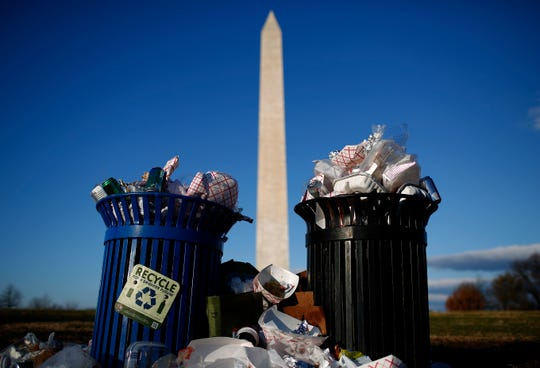 Trash begins to accumulate along the National Mall near the Washington Monument due to a partial shutdown of the federal government on Dec. 24, 2018, in Washington, D.C.