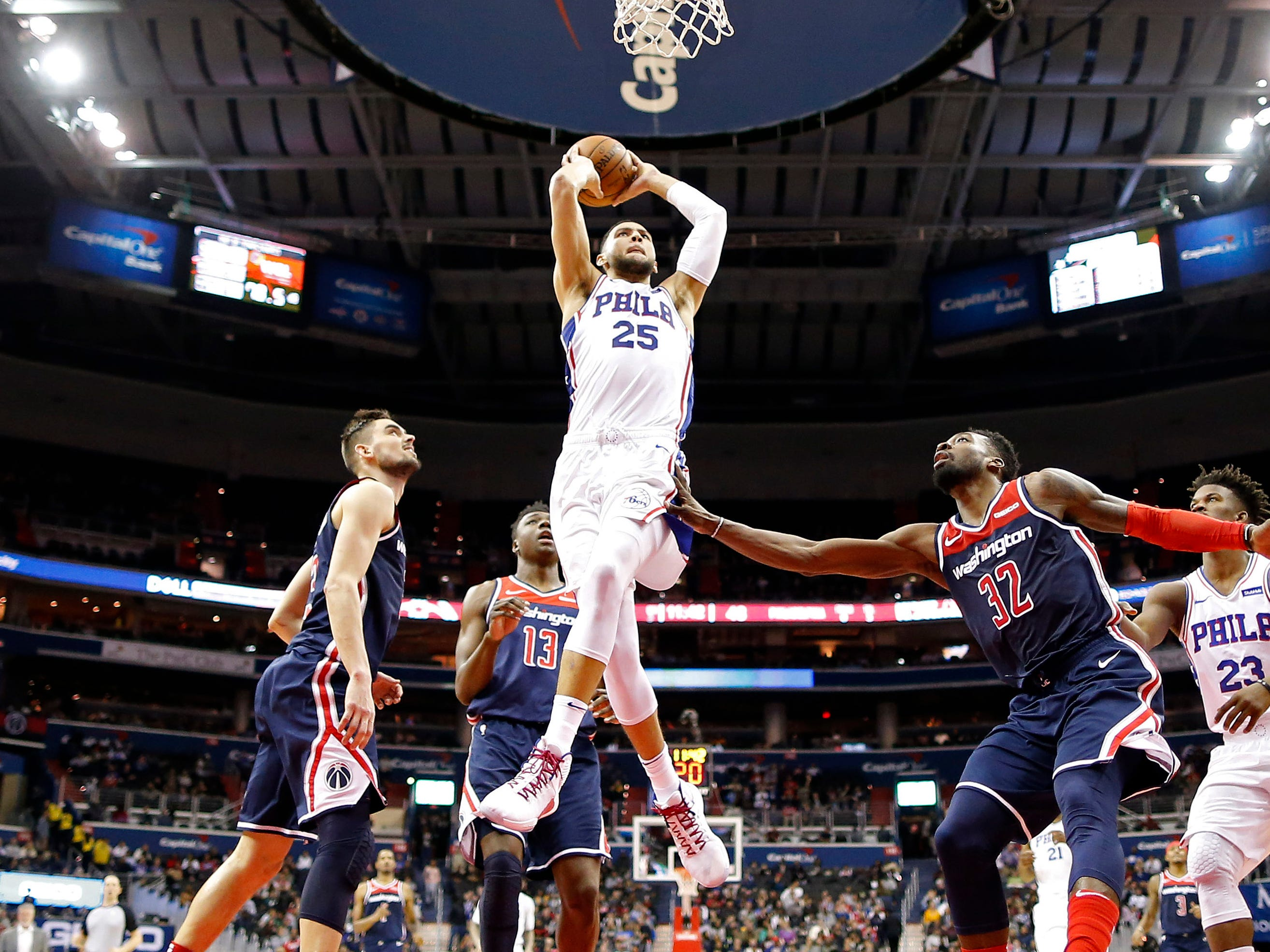 Jan. 9: Sixers guard Ben Simmons (25) drives the lane for a two-haned flush during the second half against the Wizards in Washington.