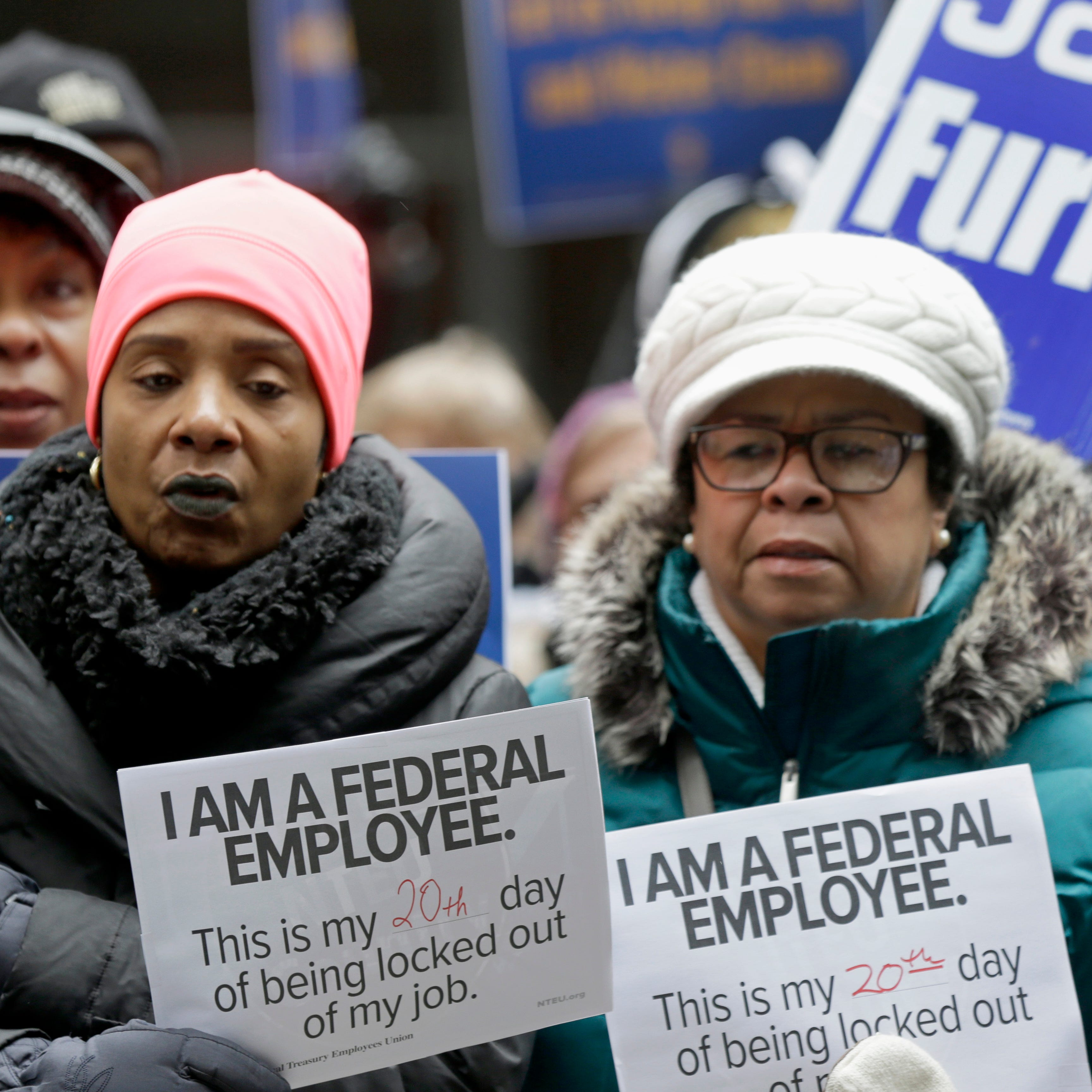 Government workers rally against the partial government shutdown at Federal Plaza,  in Chicago, Jan. 10, 2019.