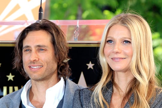 Actress Gwyneth Paltrow, right, and husband director Brad Falchuk at a Hollywood Walk of Fame ceremony in Hollywood, California, on Dec. 4, 2018.