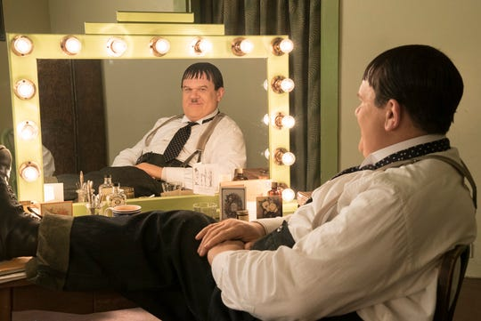 "John C. Reilly gives a smile as portly comedic legend Oliver Hardy in ""Stan & Ollie."""