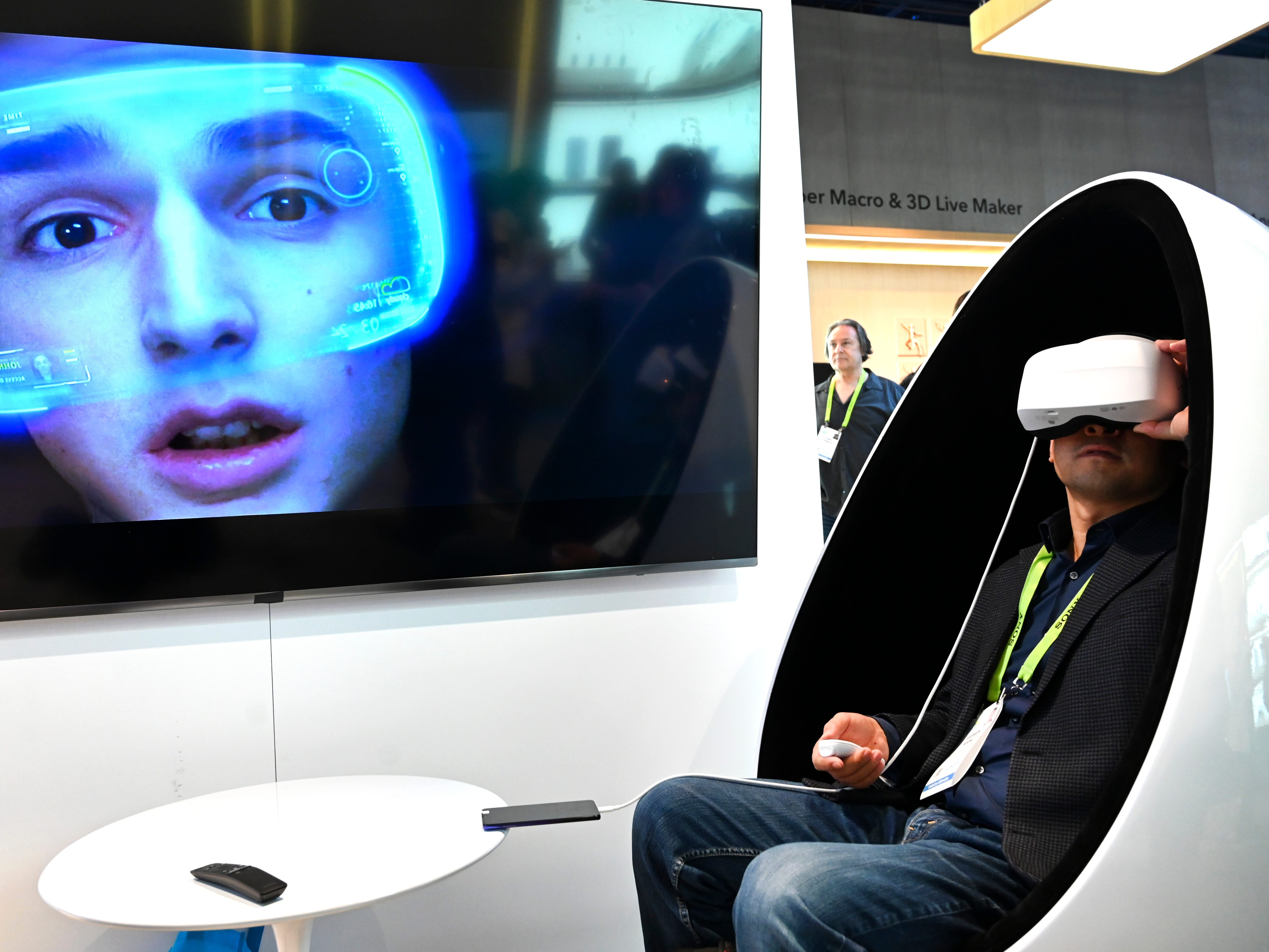 Jianing Zhang tries out Chinese electronics maker Huawei's virtual reality gaming system that can run through the Internet or through a mobile phone.