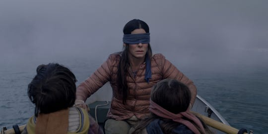 "Julian Edwards, Sandra Bullock, Vivien Lyra Blair in the motion picture ""Bird Box."" [Via MerlinFTP Drop]"