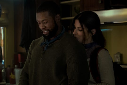 Tom and Malorie (Trevante Rhodes and Sandra Bullock) don't let the threat of the end of the world ruin their hair.