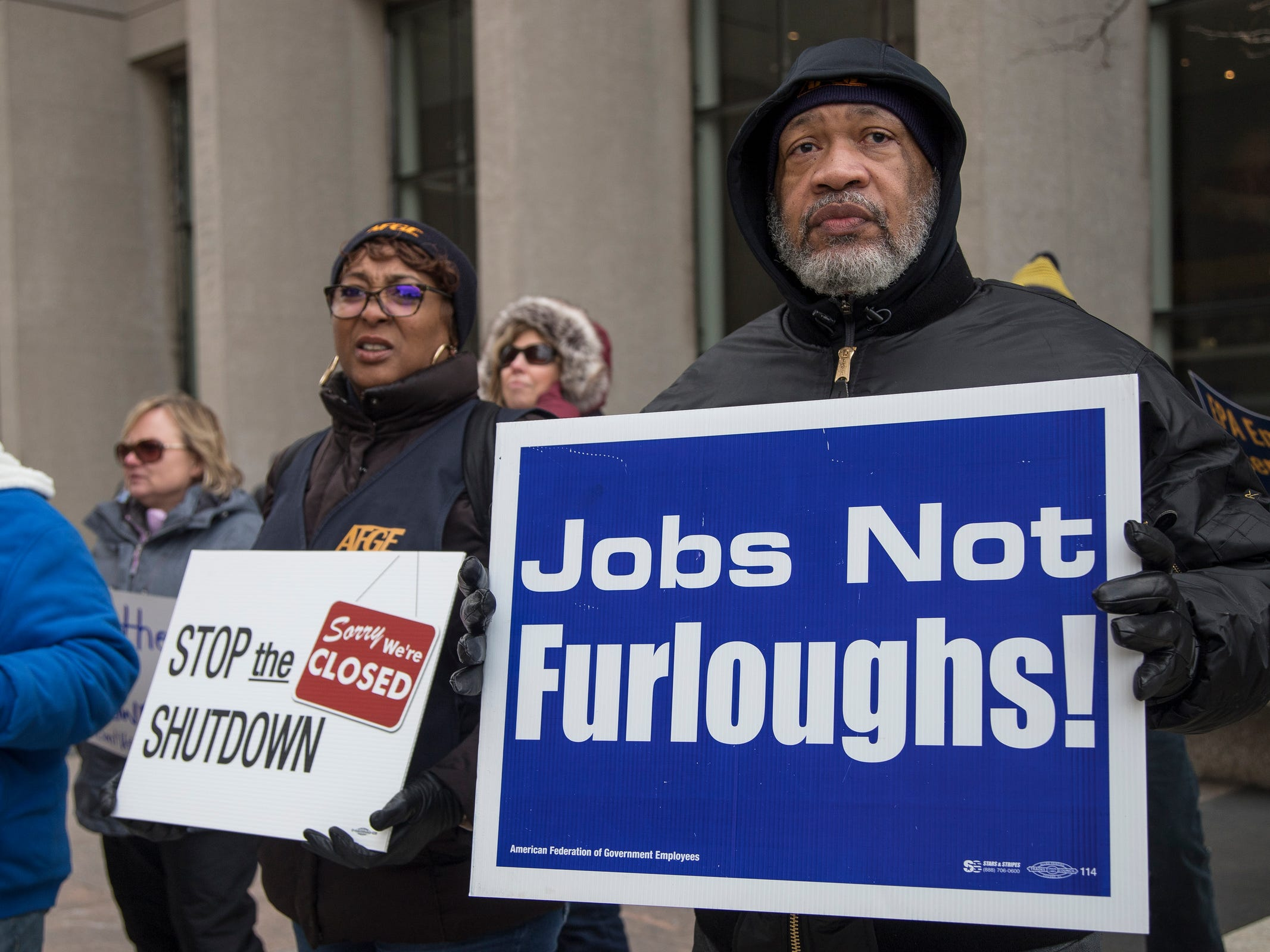 Gregory Simpkins, president of AFGE local 778 and Bertrice Sanders, Social Security Administration Roseville office employee protest the government shutdown outside of the Patrick V. McNamara Federal Building in Detroit, Jan. 10, 2019.