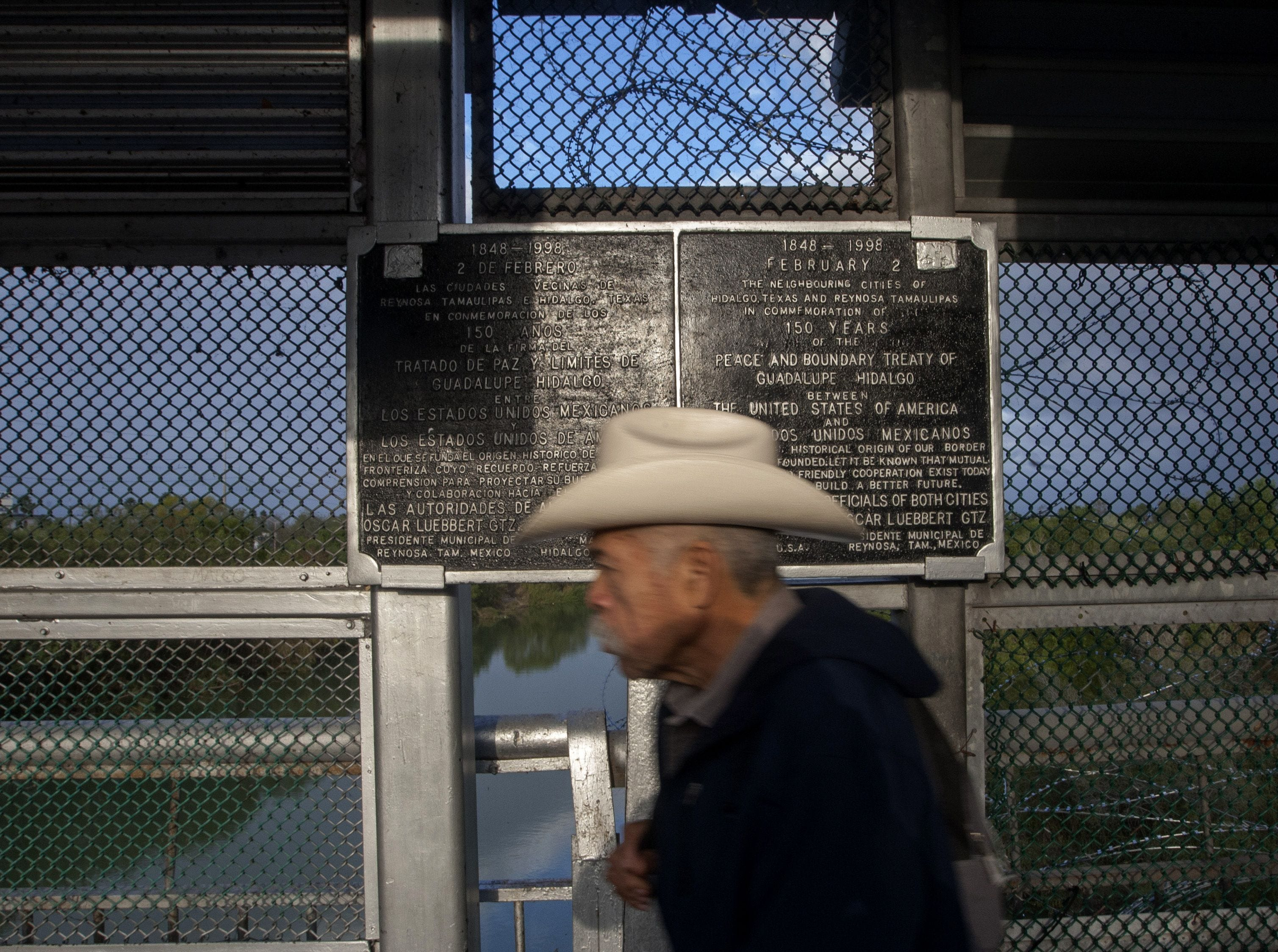 A man crosses the Reynosa-Hidalgo international bridge linking the Mexican city of Reynosa, in the state of Tamaulipas with US city of Hidalgo, in Texas, on Jan. 10, 2019.