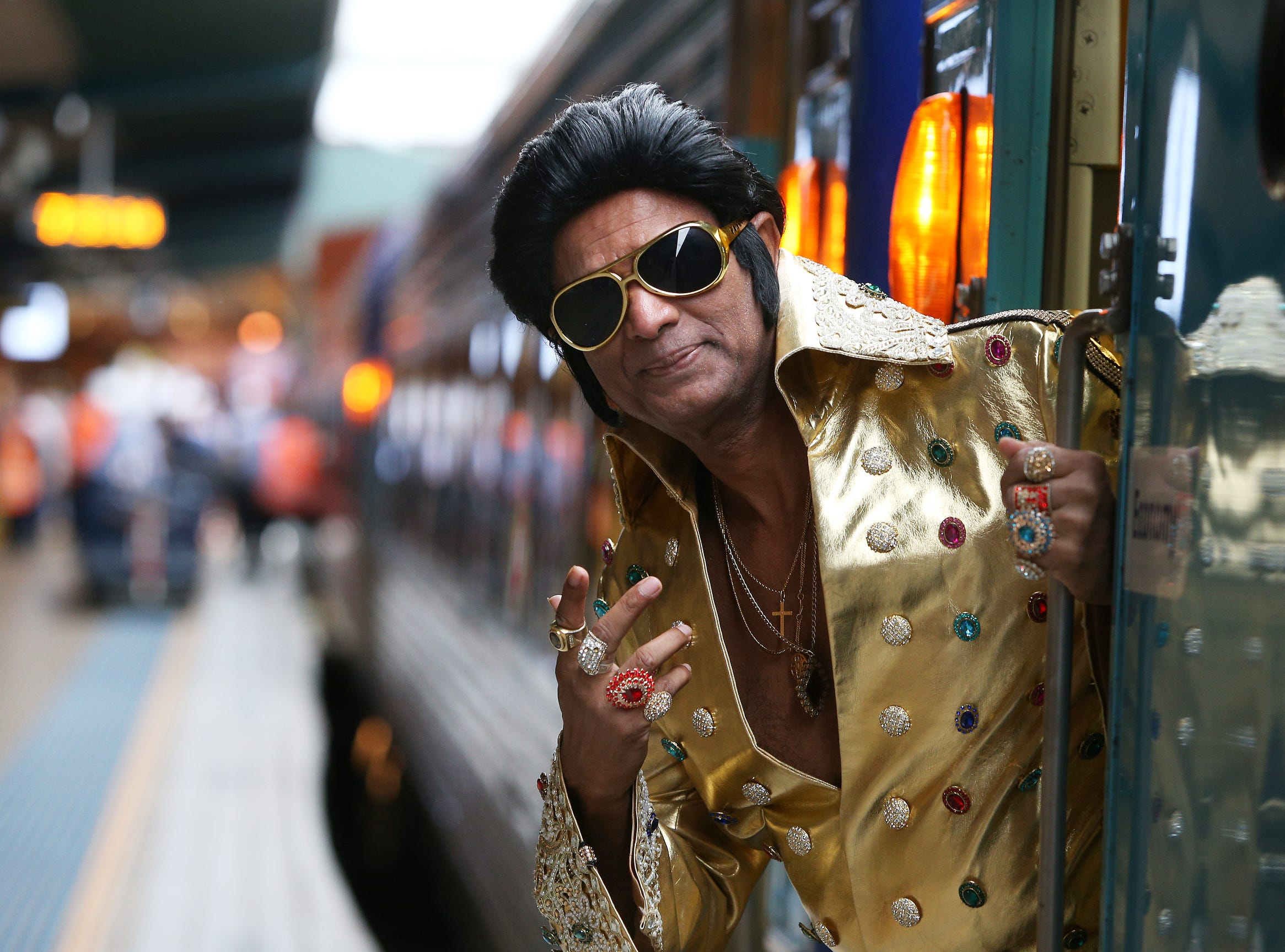 Elvis tribute artist Alfred Kaz, also known as 'Bollywood Elvis' poses at Central Station ahead of boarding the 'Elvis Express' in Sydney, Australia.