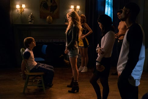 """Cole (Judah Lewis, left) runs afoul of a demonic cult of high schoolers in """"The Babysitter."""""""