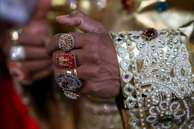 Elvis tribute artist Alfred Kaz, also known as 'Bollywood Elvis' shows off his Elvis bling!