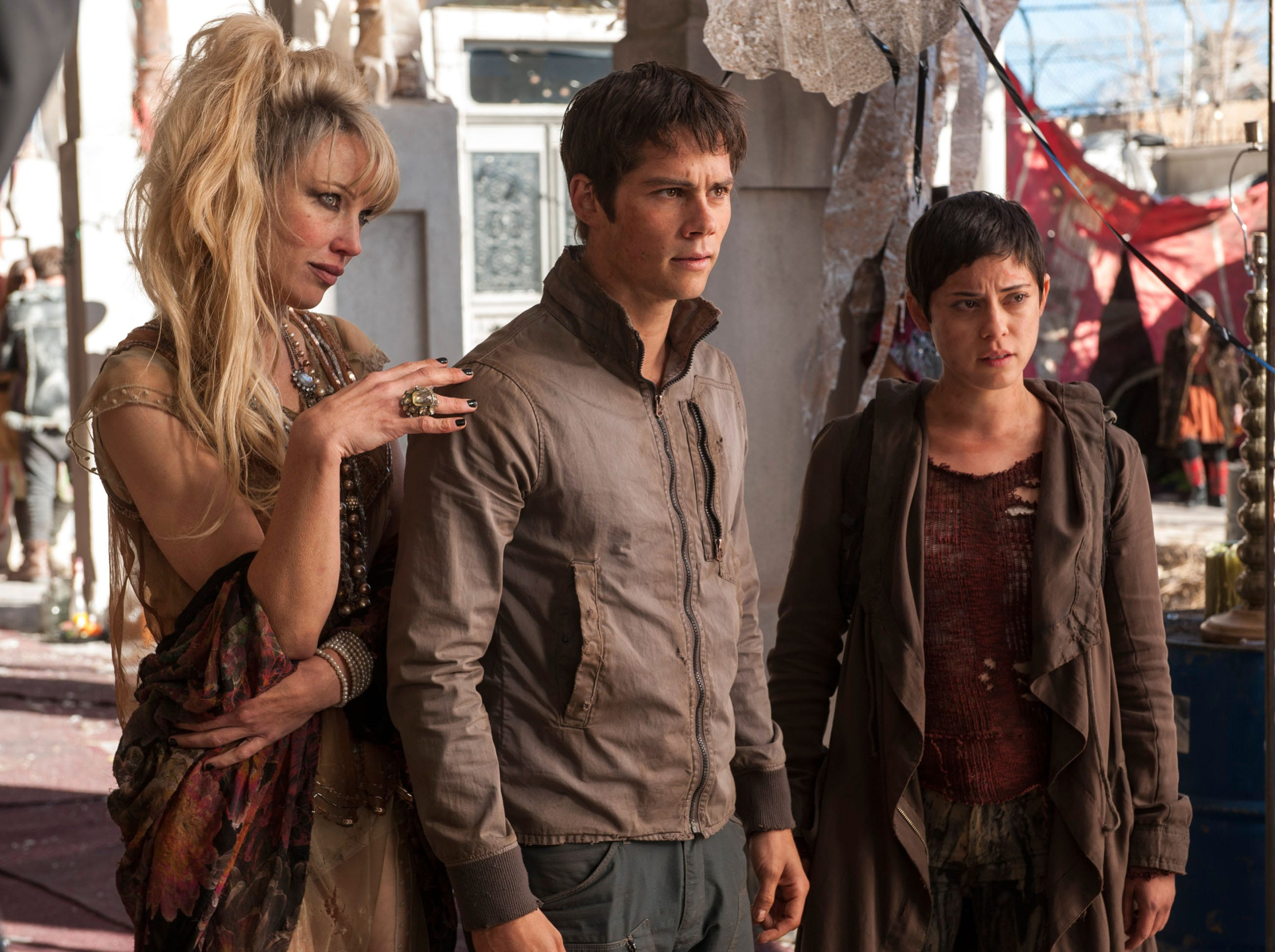 Thomas (Dylan O'Brien, center) surveys his new environment, along with Ponytail (Jenny Gabrielle, left) and Brenda (Rosa Salazar) in the motion picture 'Maze Runner: The Scorch Trials.' Credit: Richard Foreman, Jr., Twentieth Century Fox Film  [Via MerlinFTP Drop]