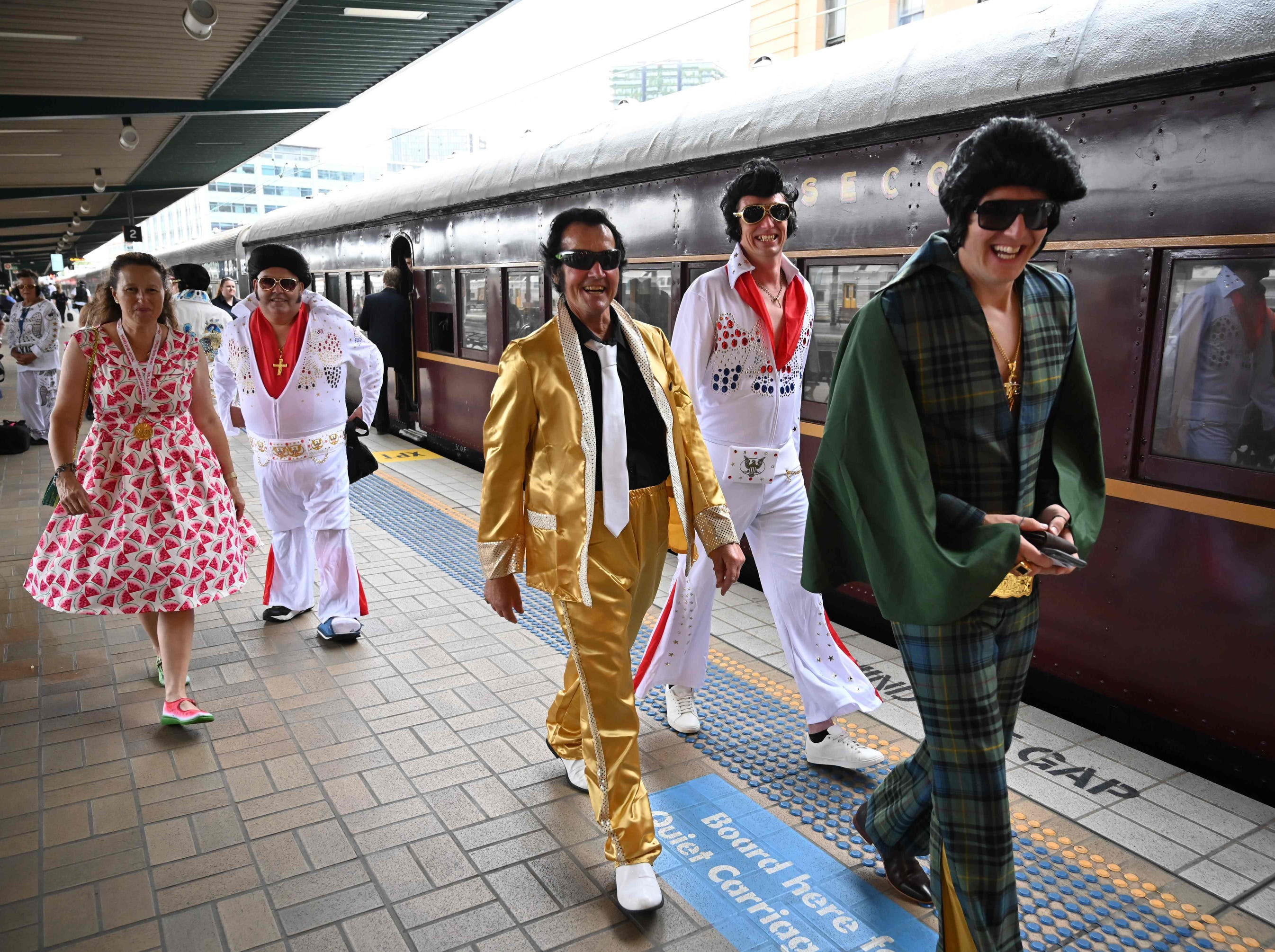 Elvis fans arrive at Central station before boarding a train to The Parkes Elvis Festival, in Sydney on Thursday.