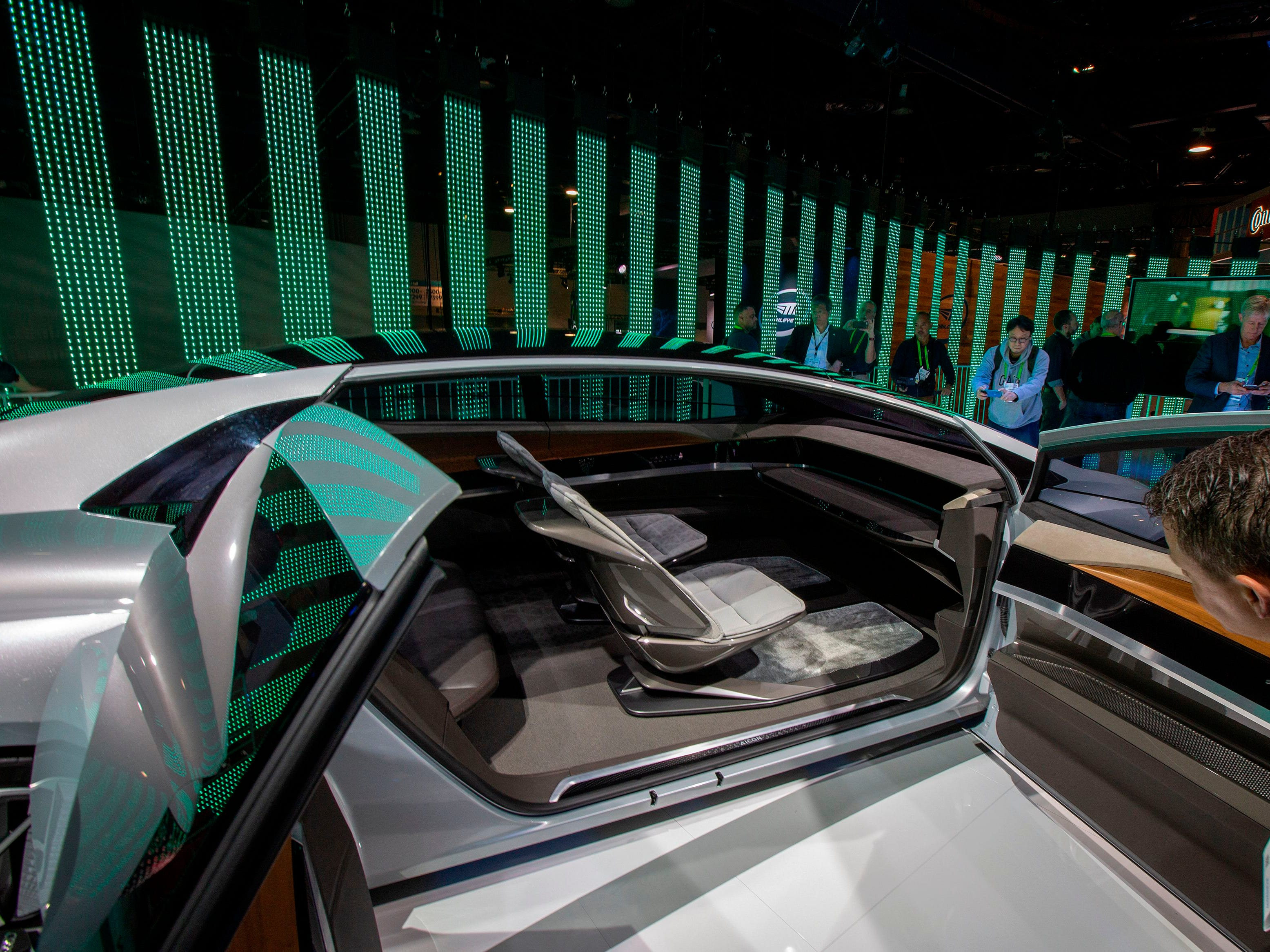 People look at the Audi Aicon concept autonomous car.